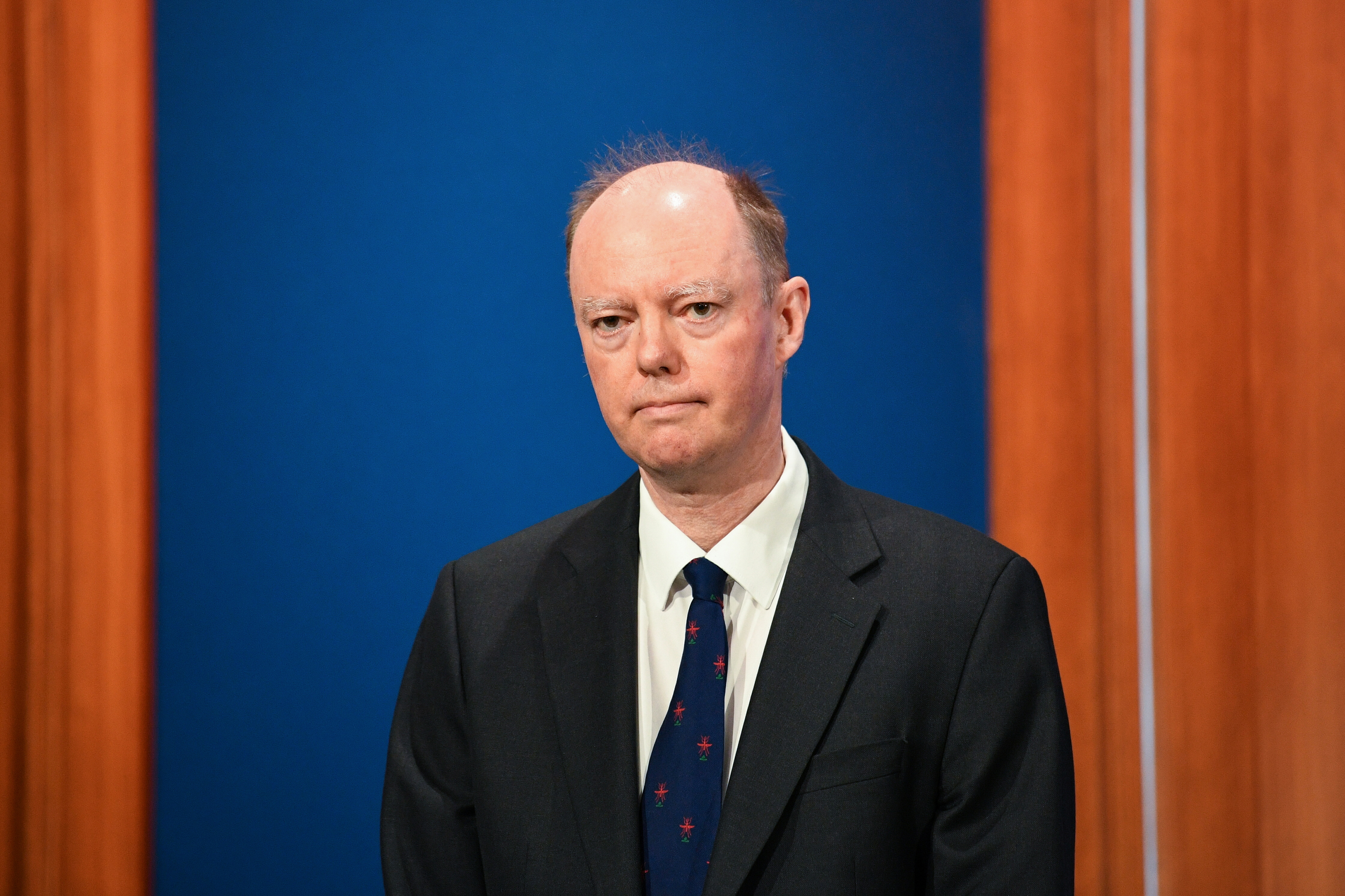 Britain's Chief Medical Officer for England Chris Whitty attends a news conference on the coronavirus disease (COVID-19) pandemic, in London, Britain April 5, 2021. Stefan Rousseau/Pool via REUTERS