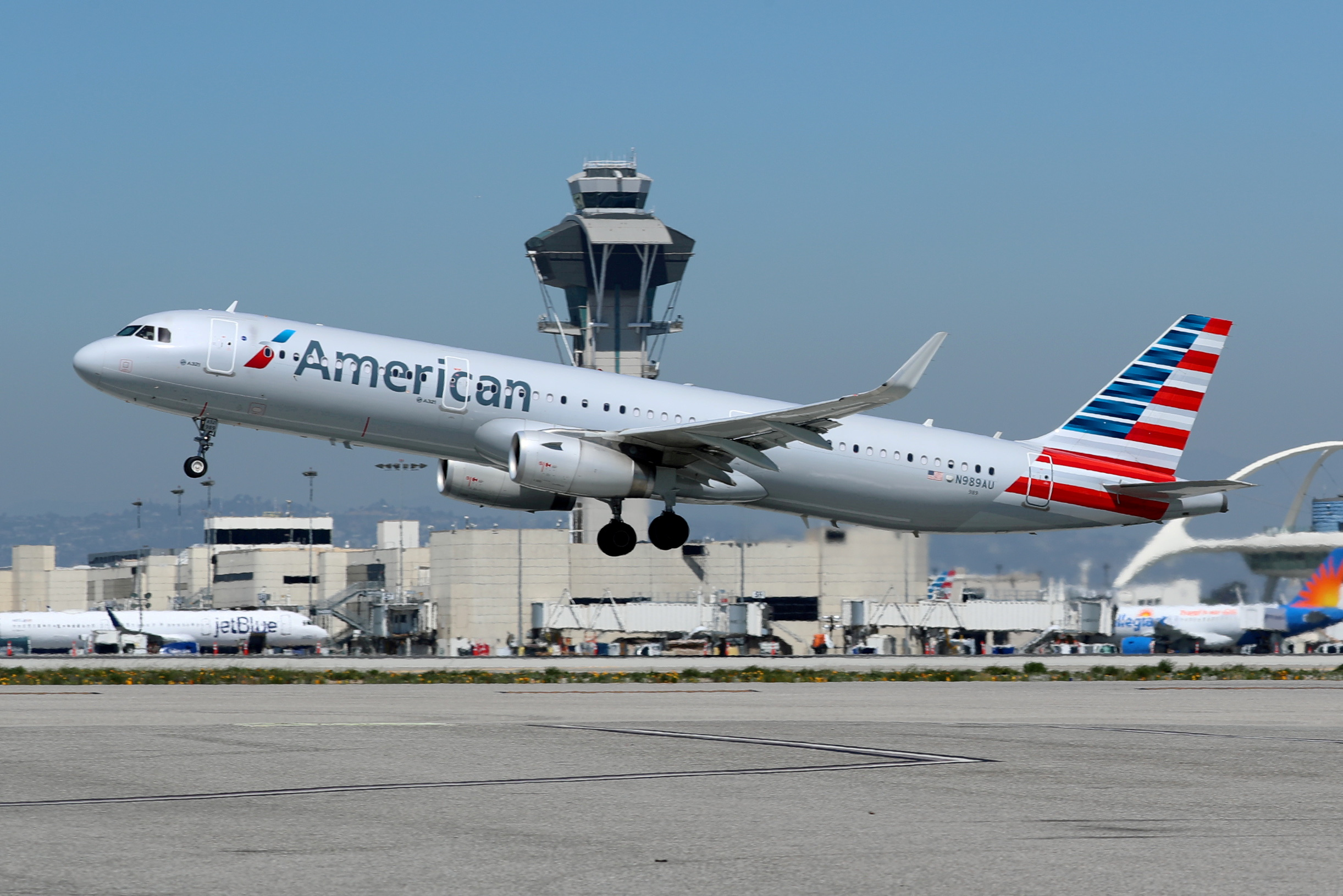 An American Airlines Airbus A321-200 plane takes off from Los Angeles International airport (LAX) in Los Angeles, California, U.S. March 28, 2018. REUTERS/Mike Blake