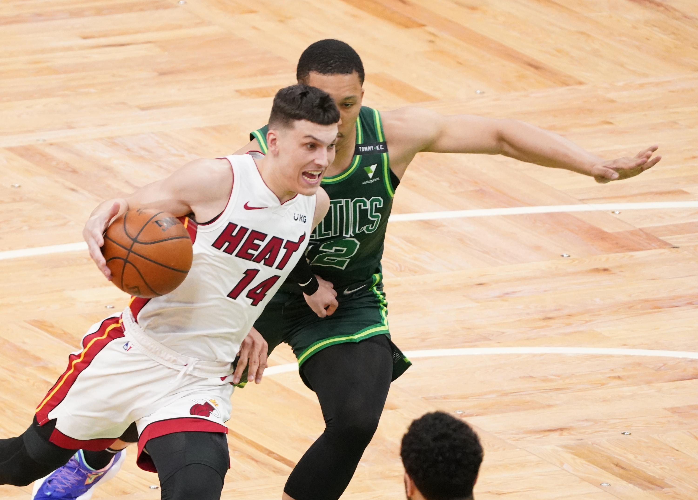May 11, 2021; Boston, Massachusetts, USA; Miami Heat guard Tyler Herro (14) drives the ball against Boston Celtics forward Grant Williams (12) in the first quarter at TD Garden. Mandatory Credit: David Butler II-USA TODAY Sports