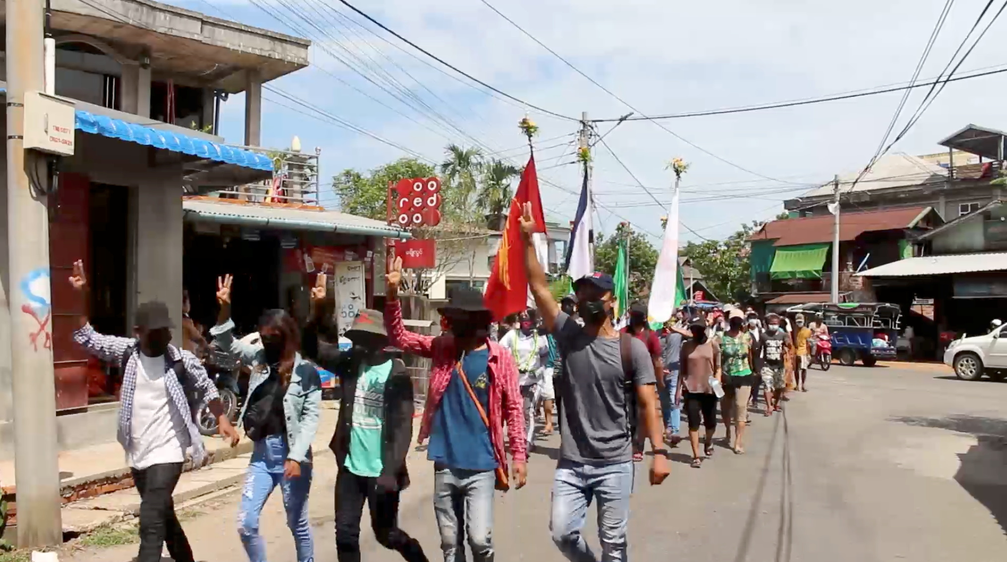 Demonstrators from the Dawei Technological University along with others march to protest against the military coup, in Dawei, Myanmar April 9, 2021 in this still image obtained from a video. Courtesy of Dawei Watch/via REUTERS