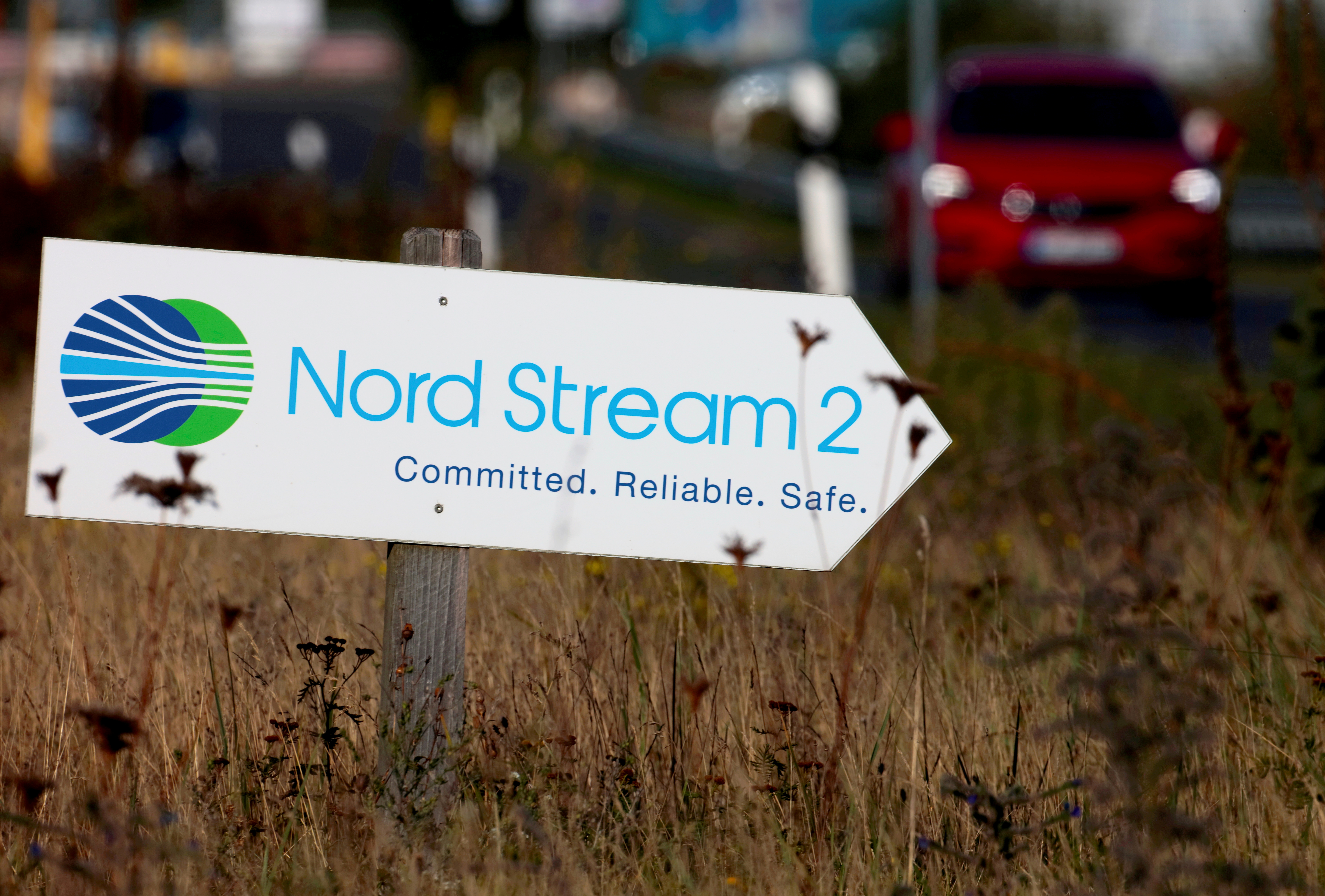 A road sign directs traffic towards the Nord Stream 2 gas line landfall facility entrance in Lubmin, Germany, September 10, 2020.   REUTERS/Hannibal Hanschke/File Photo