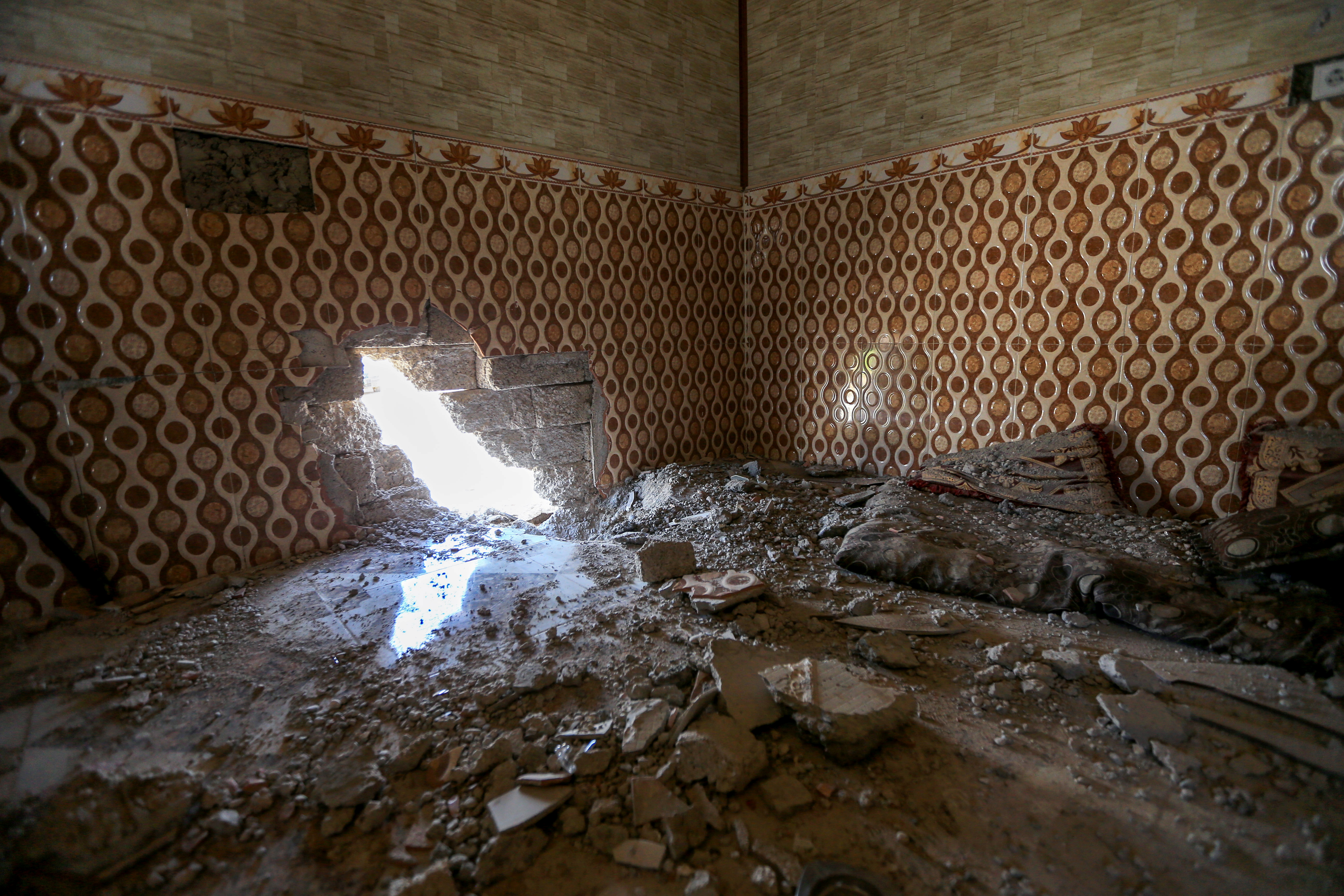 A damaged house is seen after a rocket attack on a military compound, at a village in Bashiqa region, Iraq, April 15, 2021. REUTERS/Ari Jalal