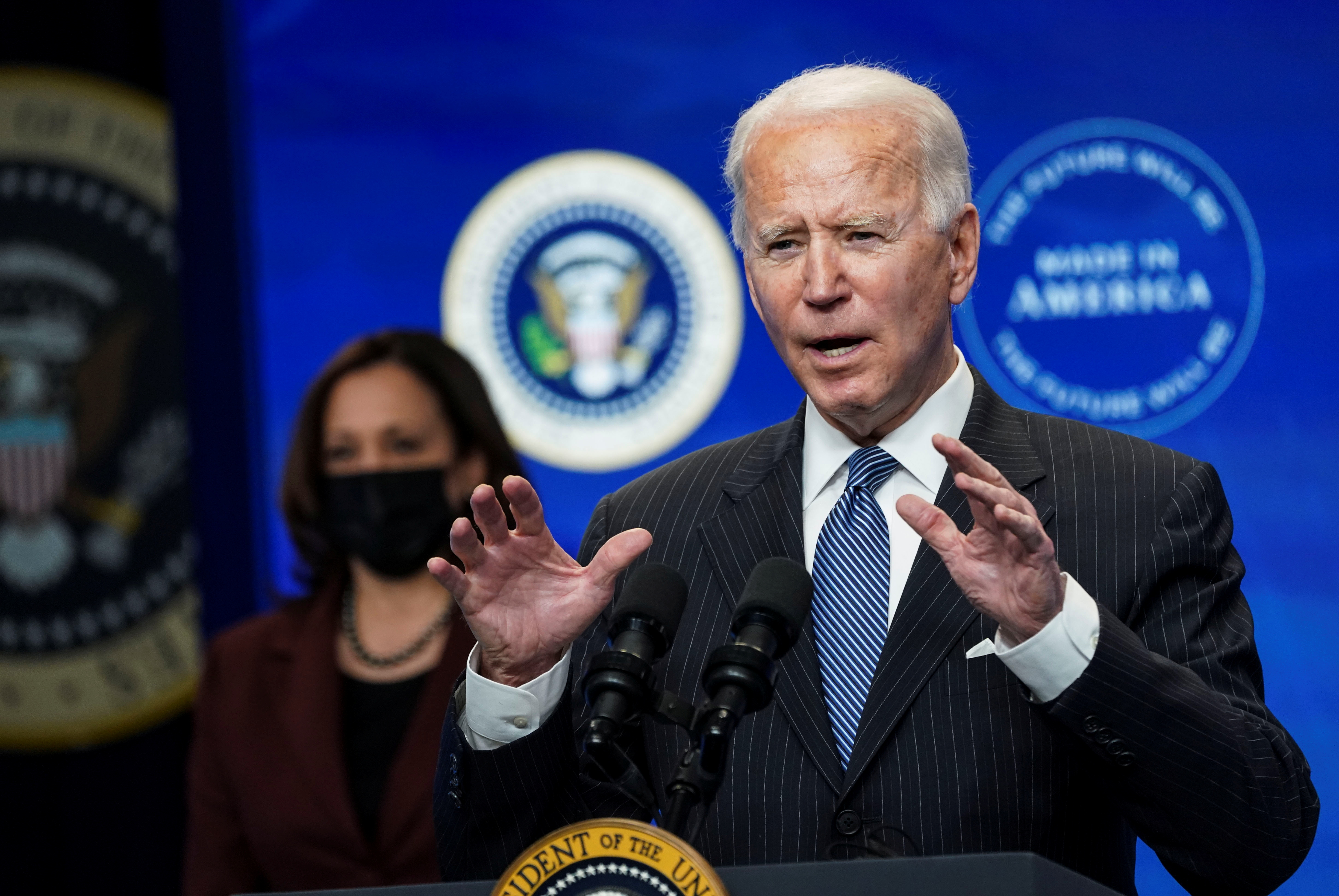 U.S. President Joe Biden speaks about administration plans to strengthen American manufacturing as Vice President Kamala Harris listens in the South Court Auditorium at the White House in Washington, U.S., January 25, 2021. REUTERS/Kevin Lamarque