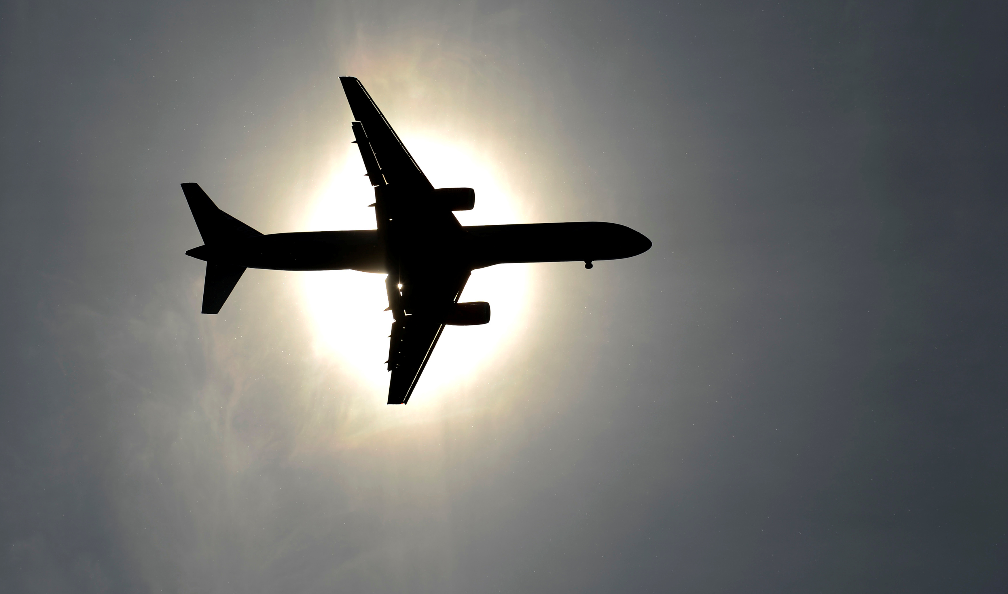 A plane approaching Leeds Bradford airport passes in front of the sun in Leeds May 26, 2013. REUTERS/Philip Brown/File Photo