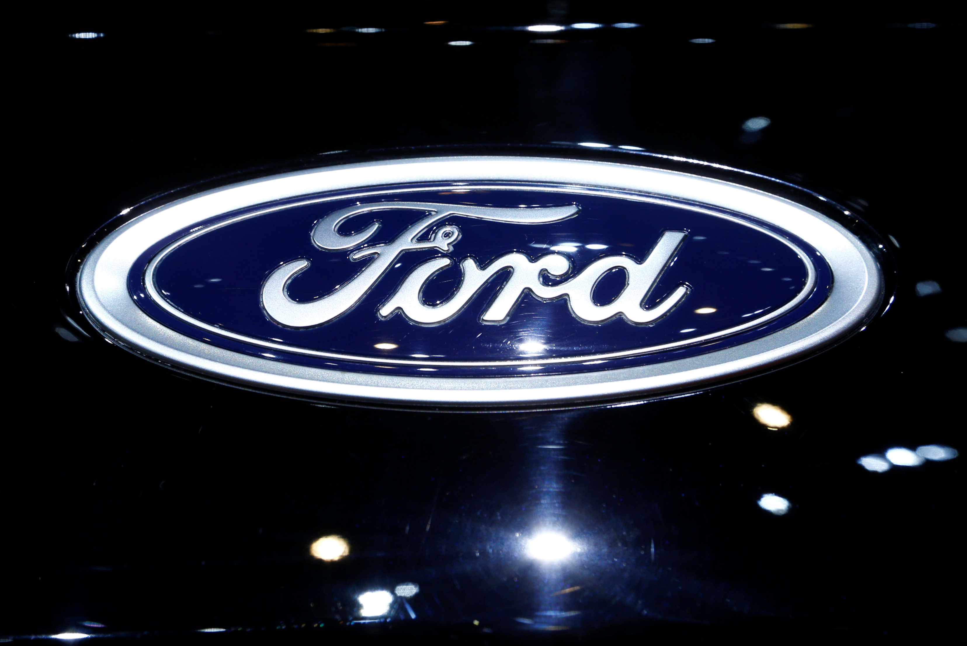 A logo of Ford is pictured on a car at the 86th International Motor Show in Geneva, Switzerland, March 1, 2016.  REUTERS/Denis Balibouse