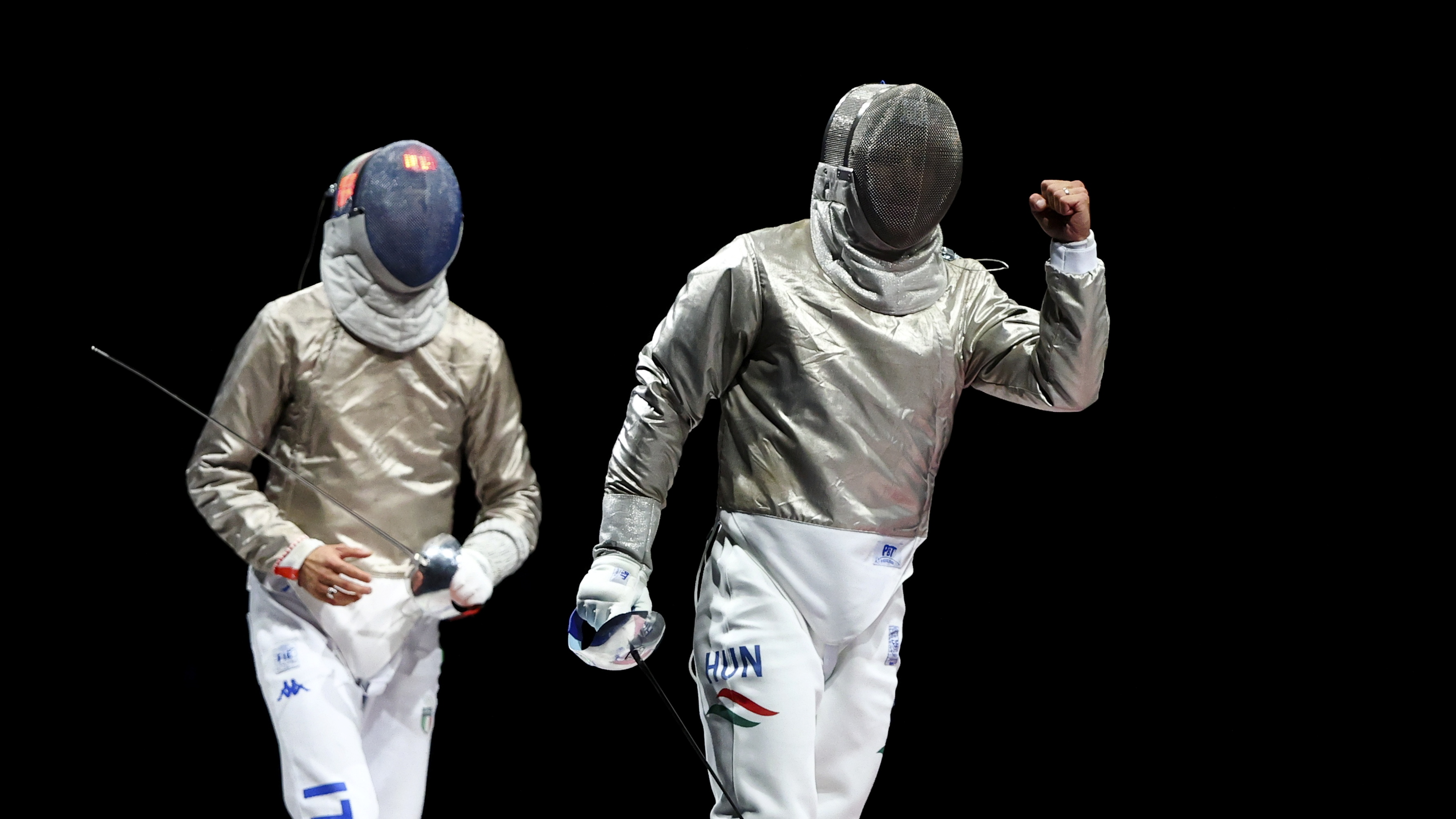 Tokyo 2020 Olympics - Fencing - Men's Individual Sabre - Gold medal match - Makuhari Messe Hall B - Chiba, Japan - July 24, 2021. Aron Szilagyi of Hungary reacts during the match as Luigi Samele of Italy looks on REUTERS/Maxim Shemetov