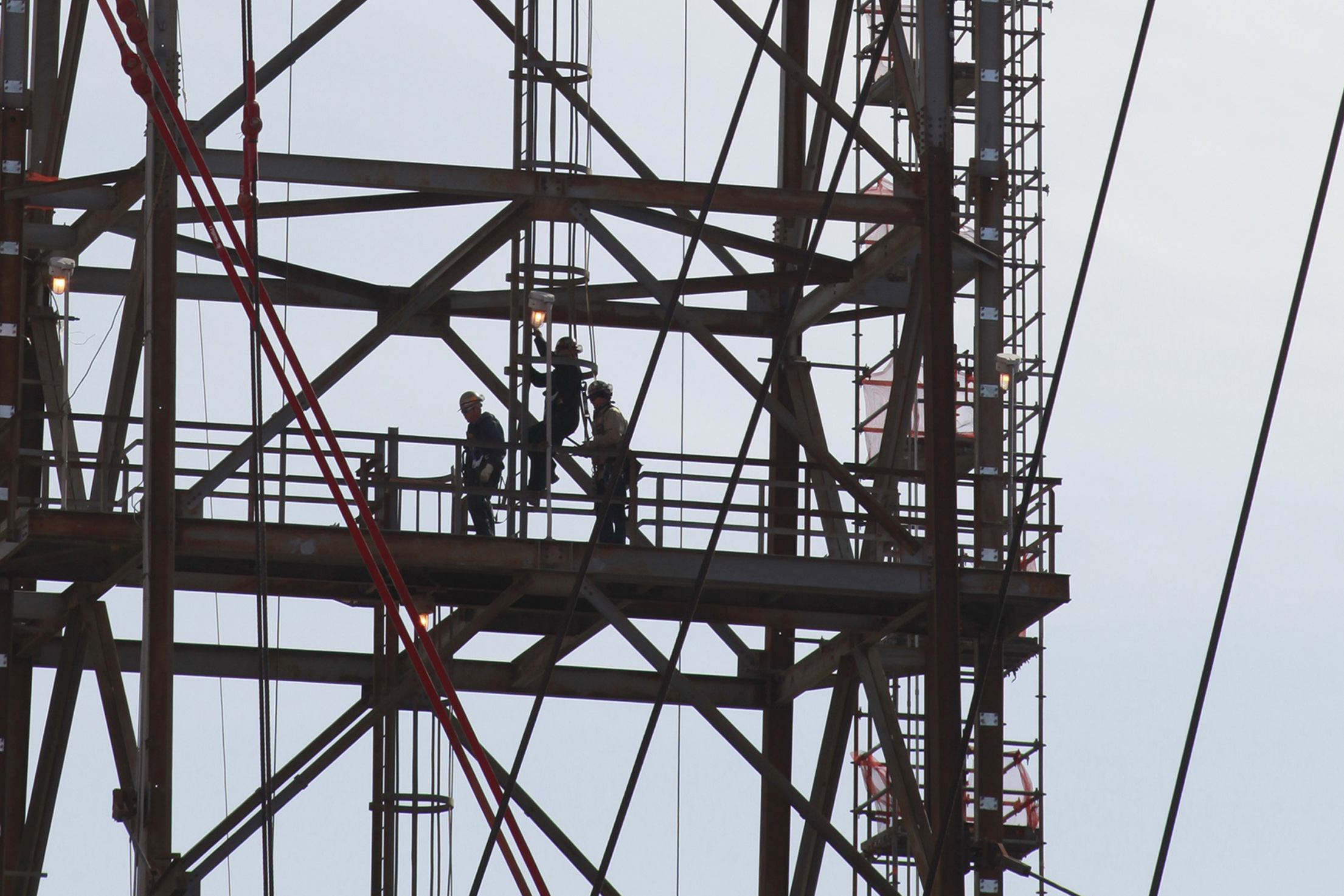 Refinery workers on a crane tower inside the LyondellBasell oil refinery in Houston, Texas March 6, 2013. REUTERS/Donna Carson
