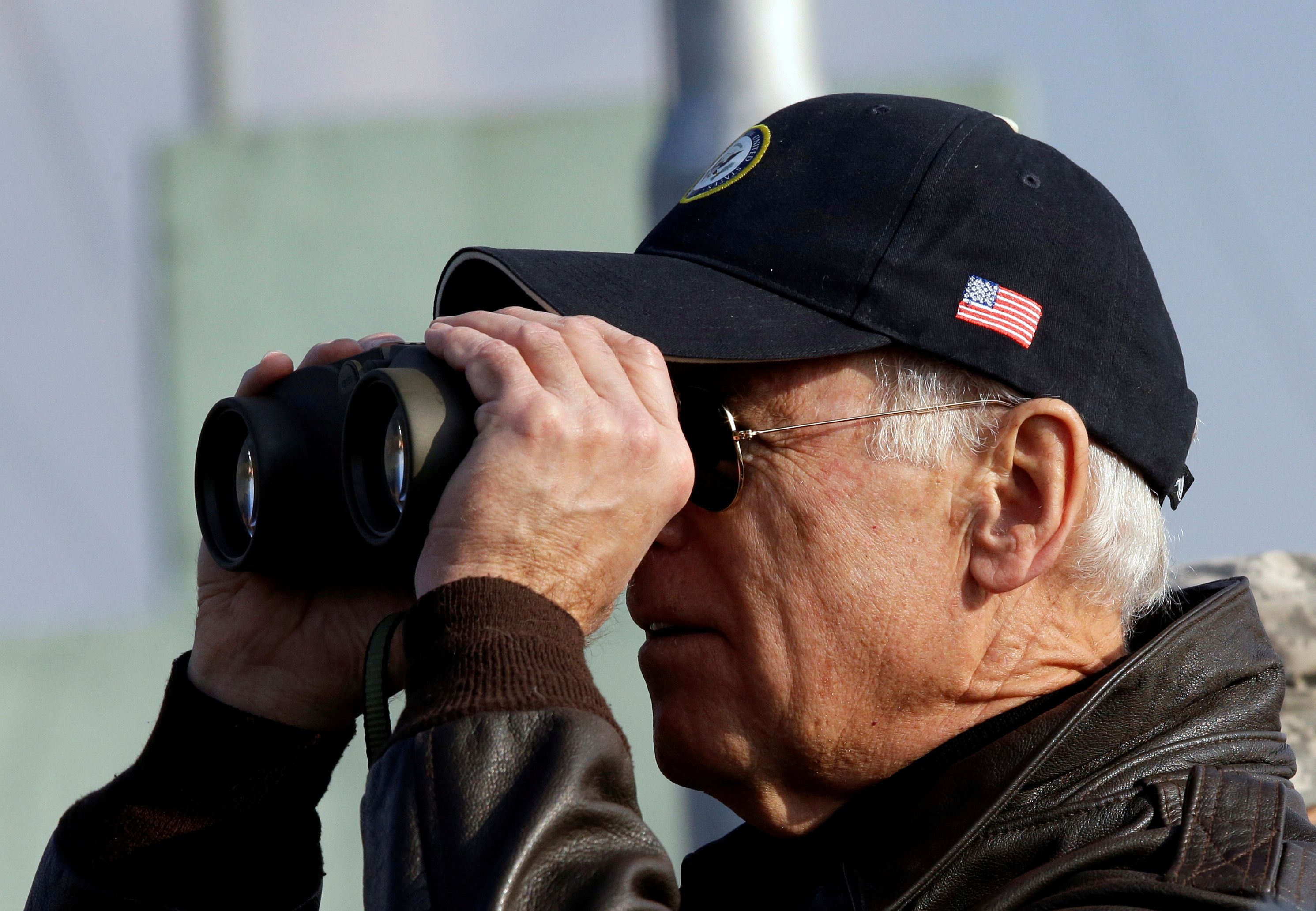 U.S. Vice President Joe Biden looks through binoculars to see North Korea from Observation Post Ouellette during a tour of the Demilitarized Zone (DMZ), the military border separating the two Koreas, in Panmunjom, December 7, 2013. REUTERS/Lee Jin-man/Pool