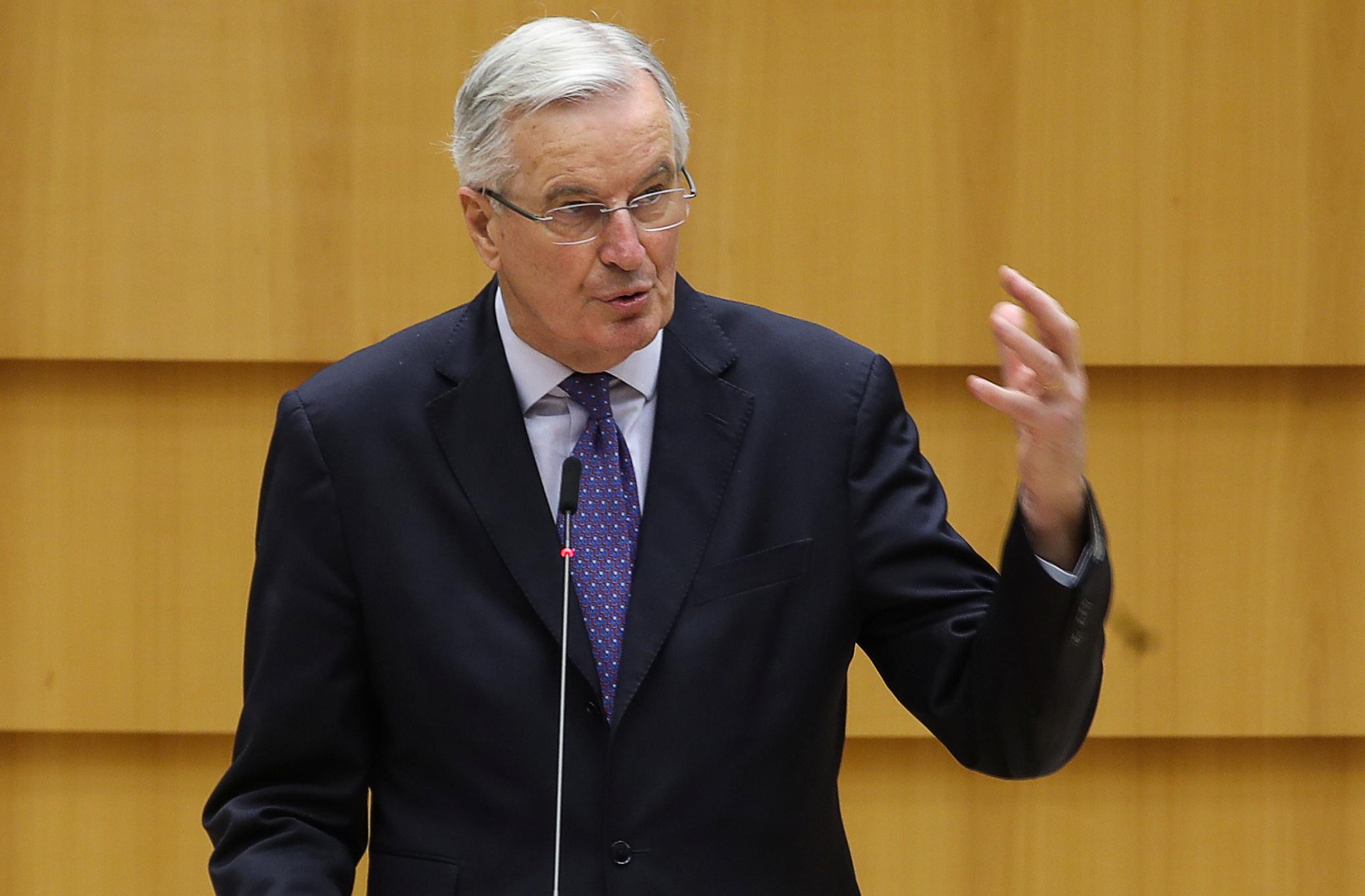 EU chief Brexit negotiator Michel Barnier gestures as he addresses the European Parliament in Brussels, Belgium, December 18, 2020. REUTERS/Yves Herman