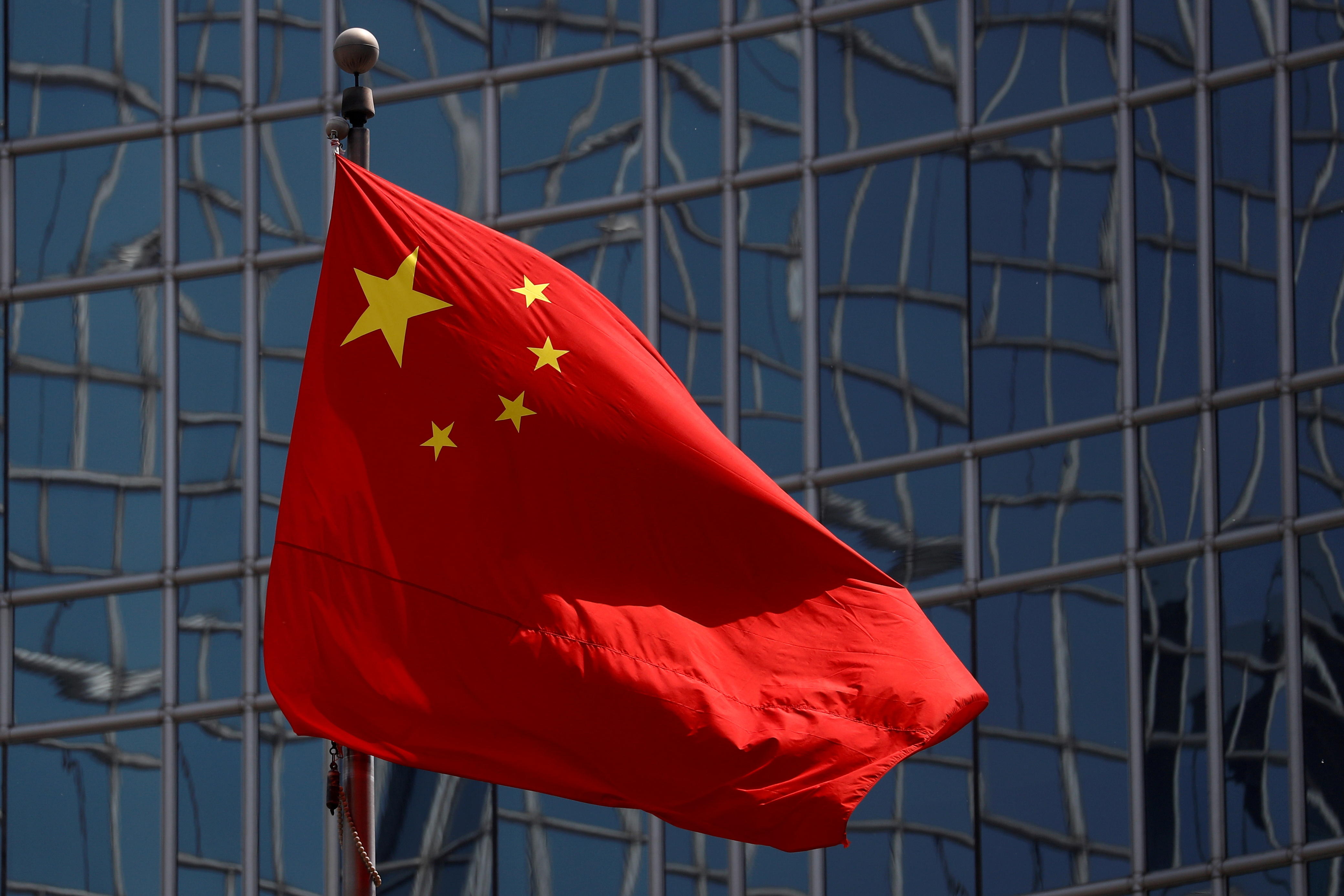 The Chinese national flag is seen in Beijing, China April 29, 2020. REUTERS/Thomas Peter/File Photo