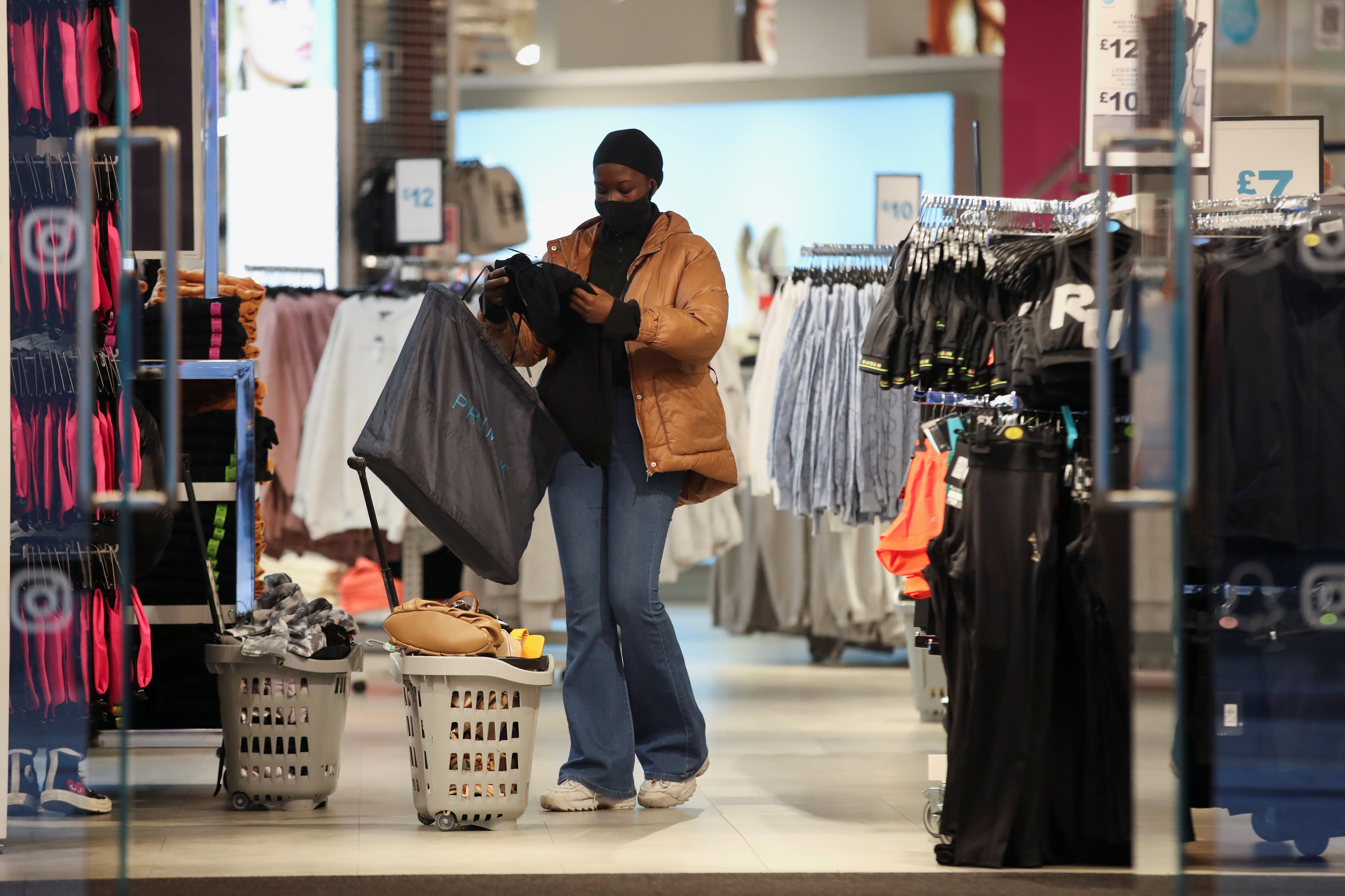A customer shops inside, as retail store Primark in Birmingham, Britain reopens its doors after a third lockdown imposed in early January due to the ongoing coronavirus disease (COVID-19) pandemic, April 12, 2021. REUTERS/Carl Recine