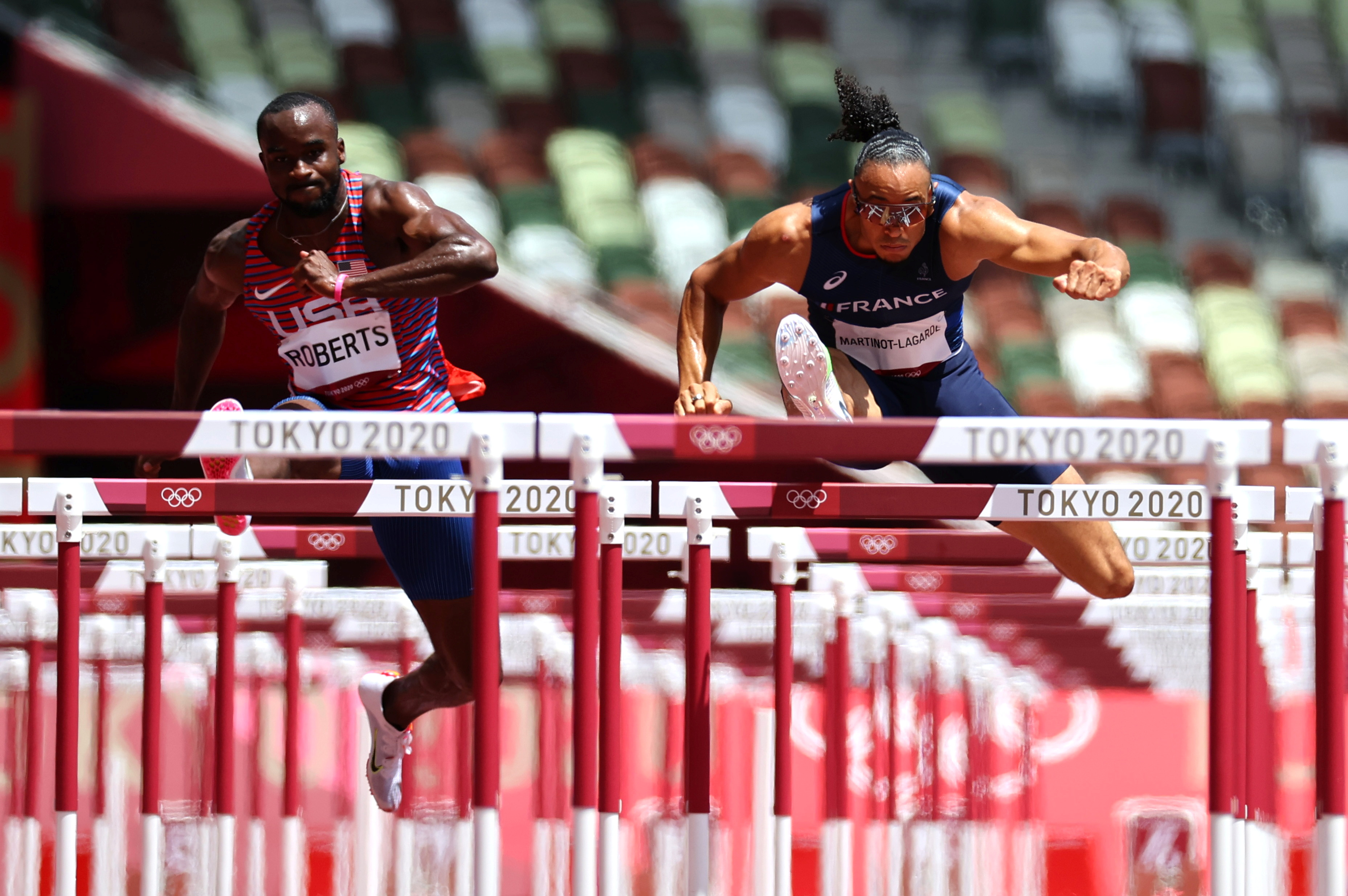 Tokyo 2020 Olympics - Athletics - Men's 110m Hurdles - Semifinal - Olympic Stadium, Tokyo, Japan - August 4, 2021. Pascal Martinot-Lagarde of France and Daniel Roberts of the United States in action in Semifinal 1 REUTERS/Lucy Nicholson     TPX IMAGES OF THE DAY - SP1EH8405Y0Y9