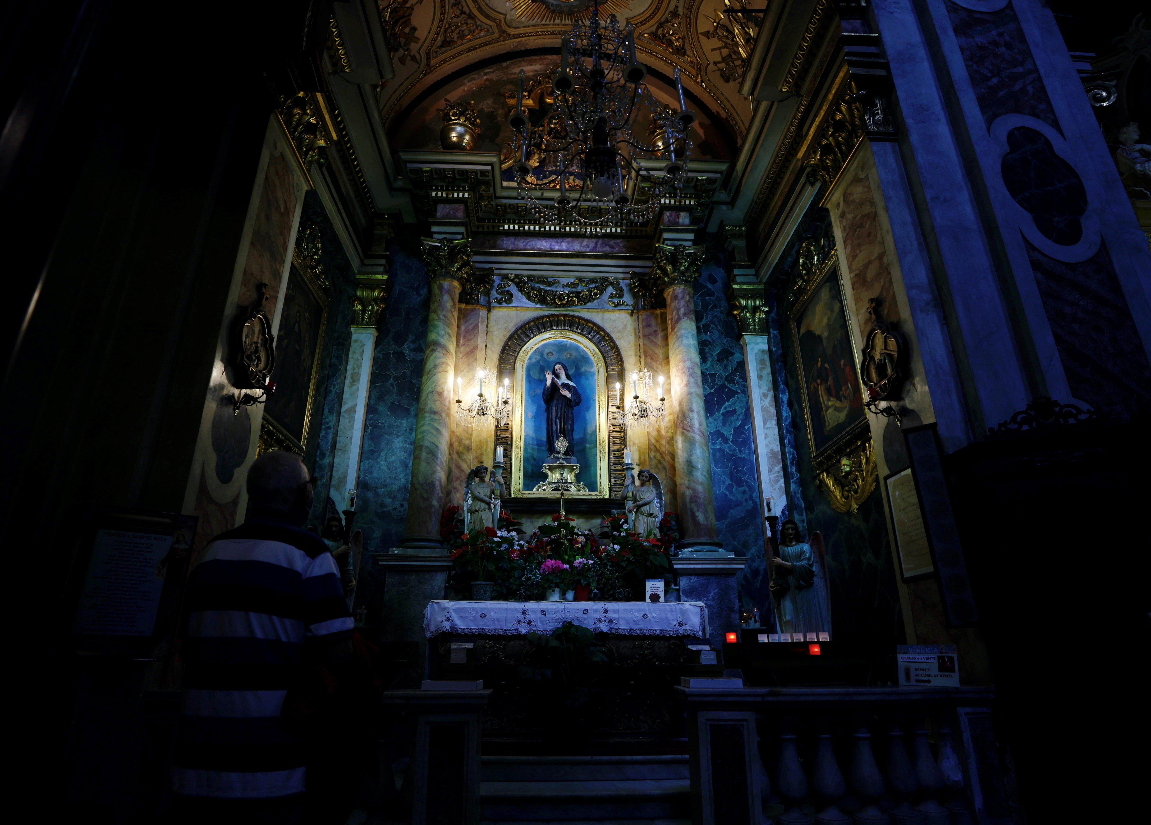 A man prays in Notre-Dame Basilica in Nice, France, October 4, 2021.  REUTERS/Eric Gaillard