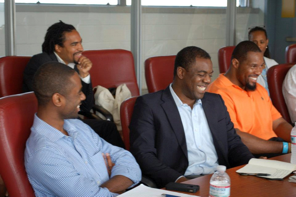 Donnel Baird (C) sits with other Echoing Green Black Male Achievement Fellows in New York, U.S., during a presentation in this 2012 handout picture.  Echoing Green/Handout via REUTERS