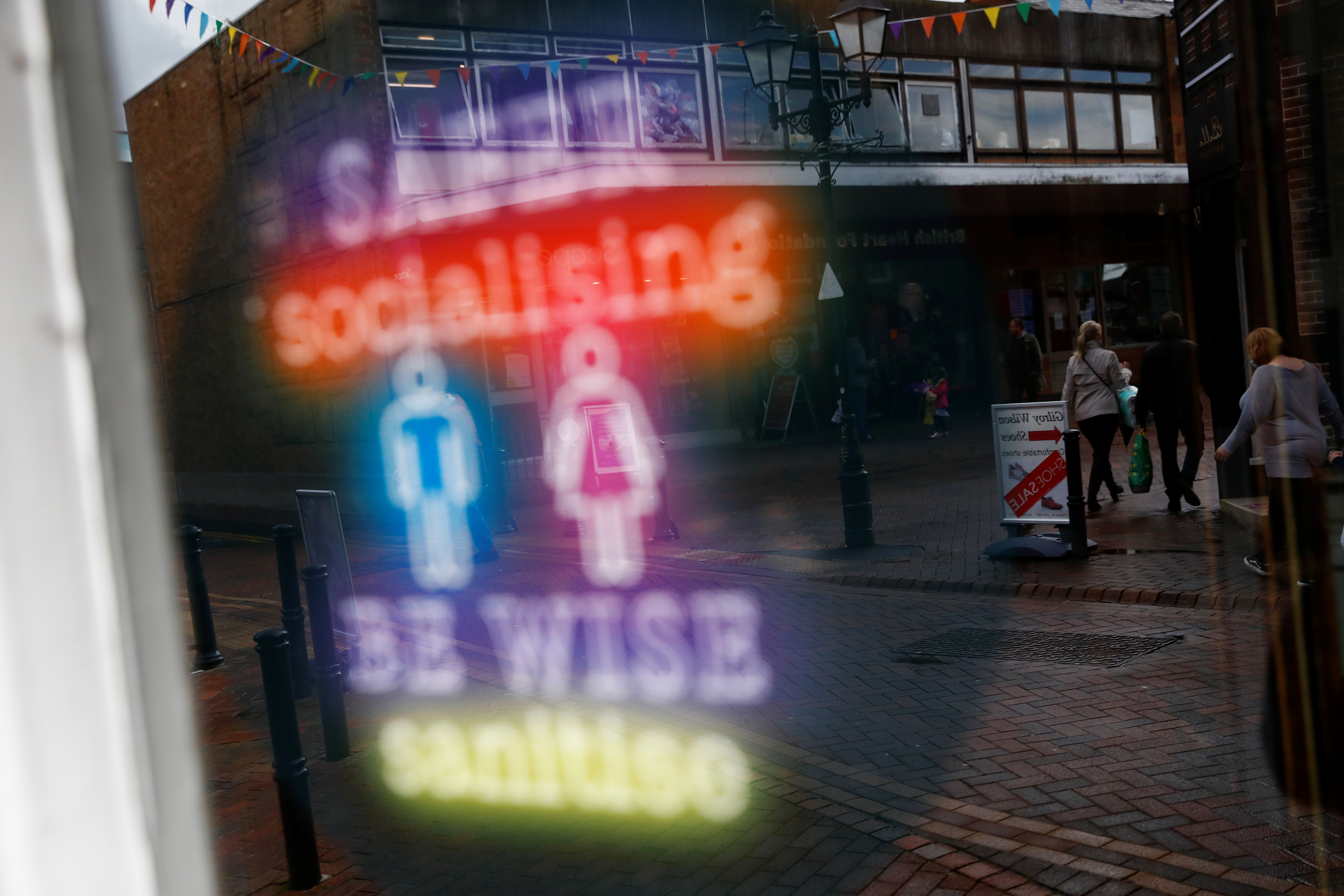 A sign advising sanitising is seen at The Swinging Witch, as lockdown eases amid the coronavirus disease (COVID-19) pandemic, in Northwich, Cheshire, Britain, May 15, 2021. REUTERS/Jason Cairnduff