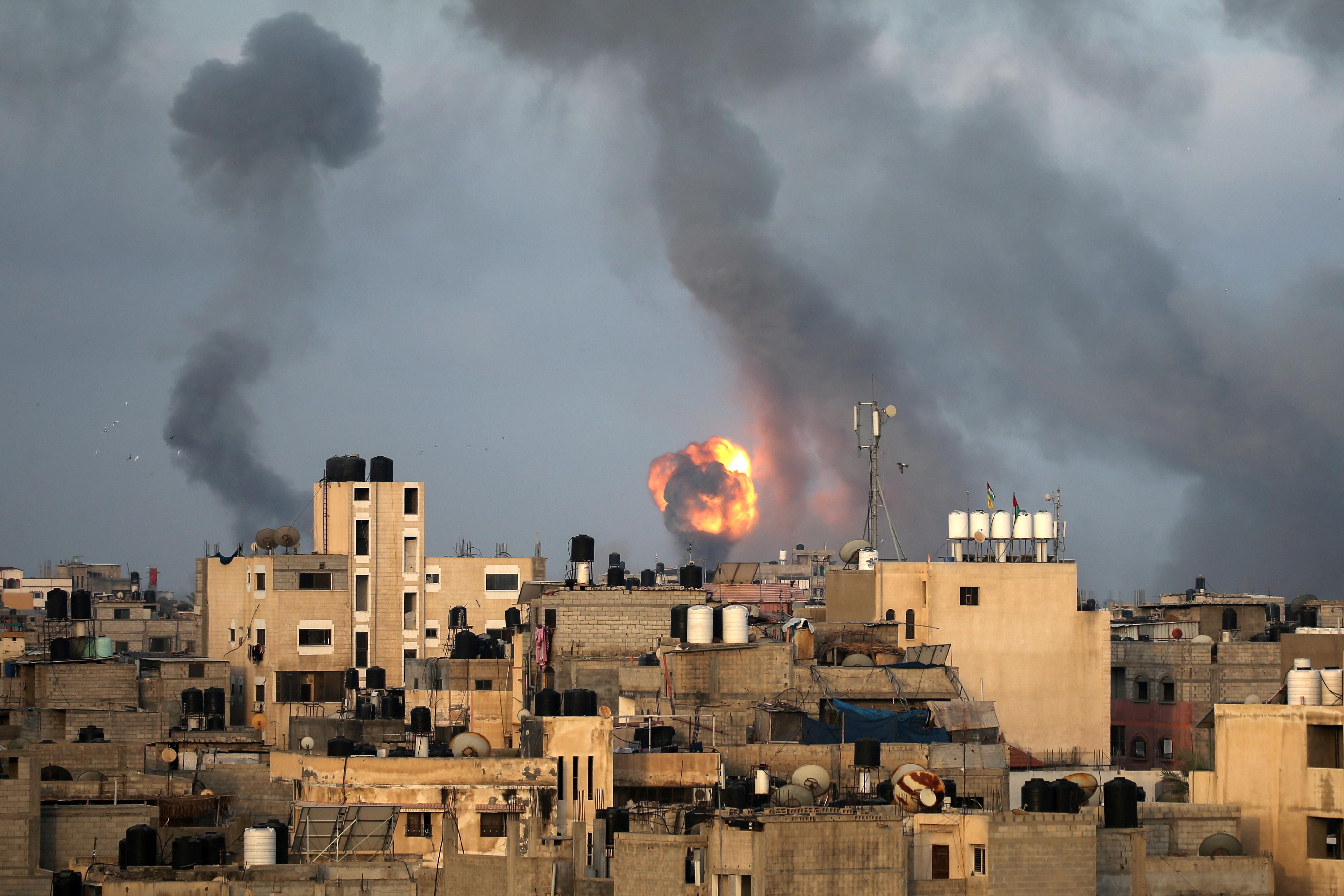 Flames and smoke rise during Israeli air strikes amid a flare-up of Israel-Palestinian violence, in the southern Gaza Strip May 11, 2021. REUTERS/Ibraheem Abu Mustafa