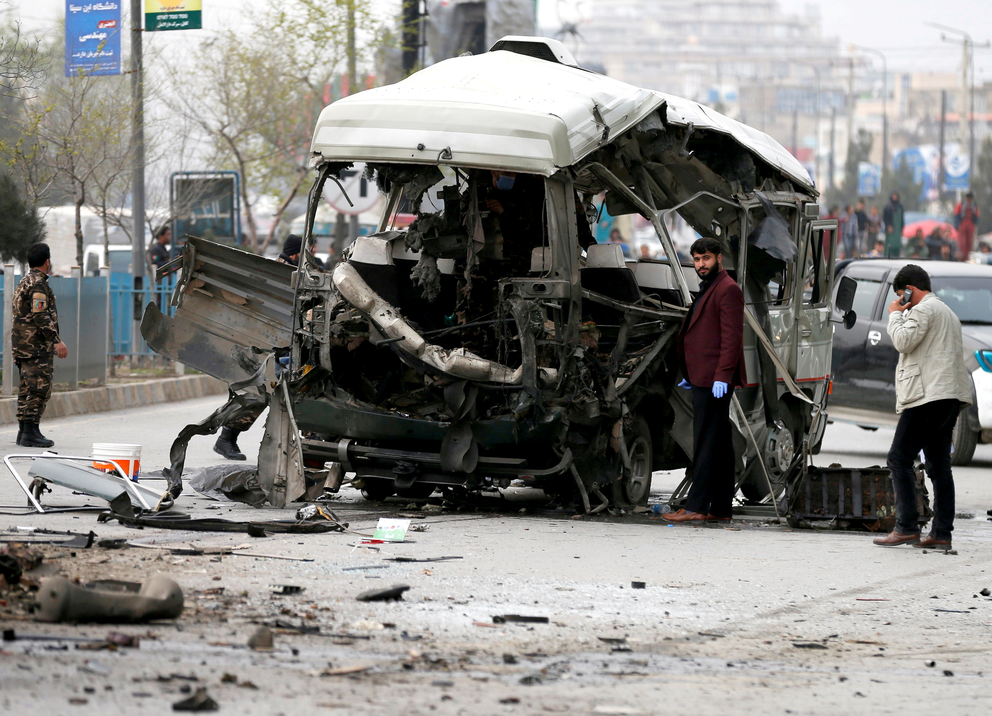 Afghan officials inspect a damaged minibus after a blast in Kabul, Afghanistan March 15, 2021. REUTERS/Mohammad Ismail/File Photo/File Photo