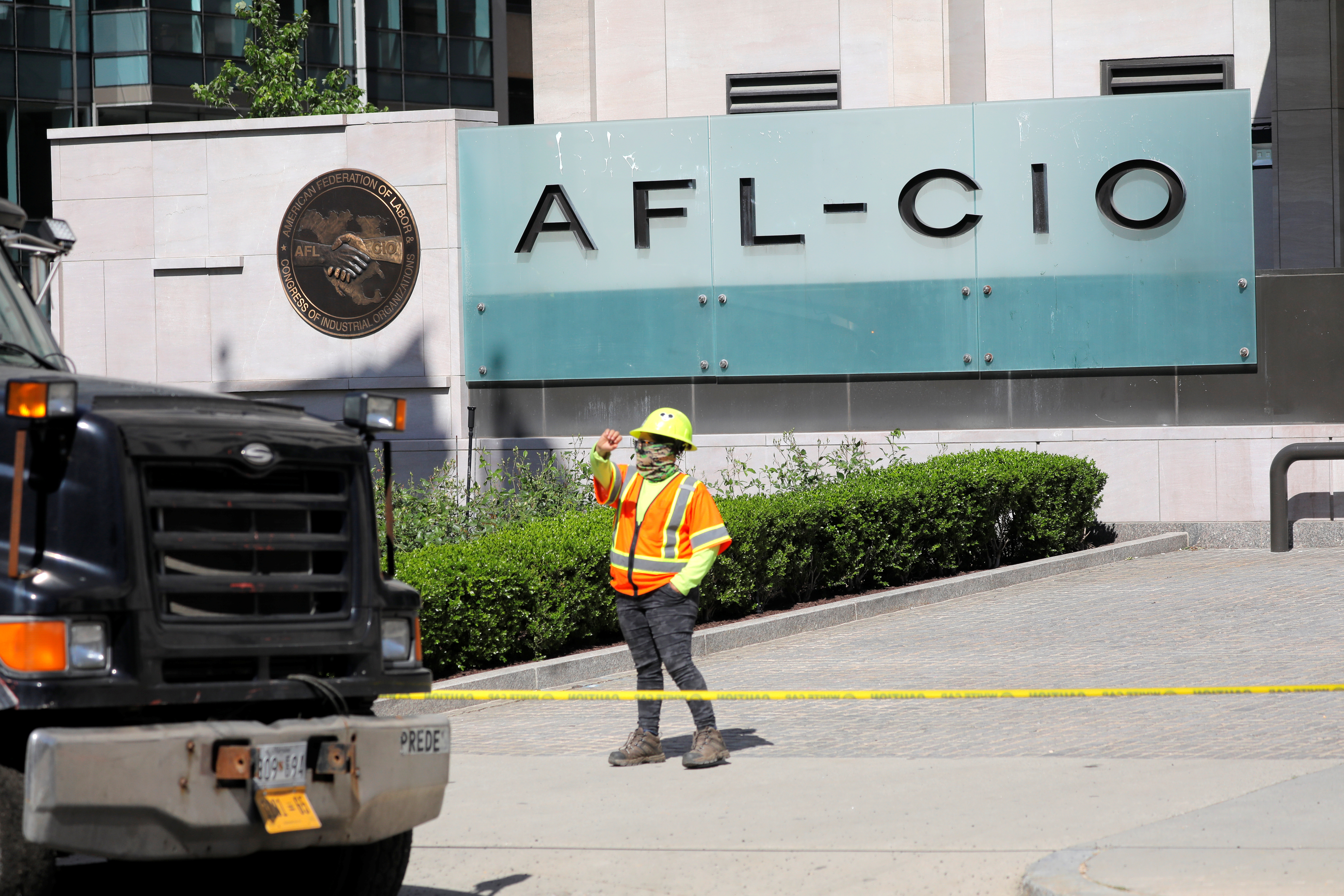 Workers resurface a road outside the headquarters of The American Federation of Labor and Congress of Industrial Organizations (AFL-CIO) in Washington, D.C., U.S., May 10, 2021. REUTERS/Andrew Kelly