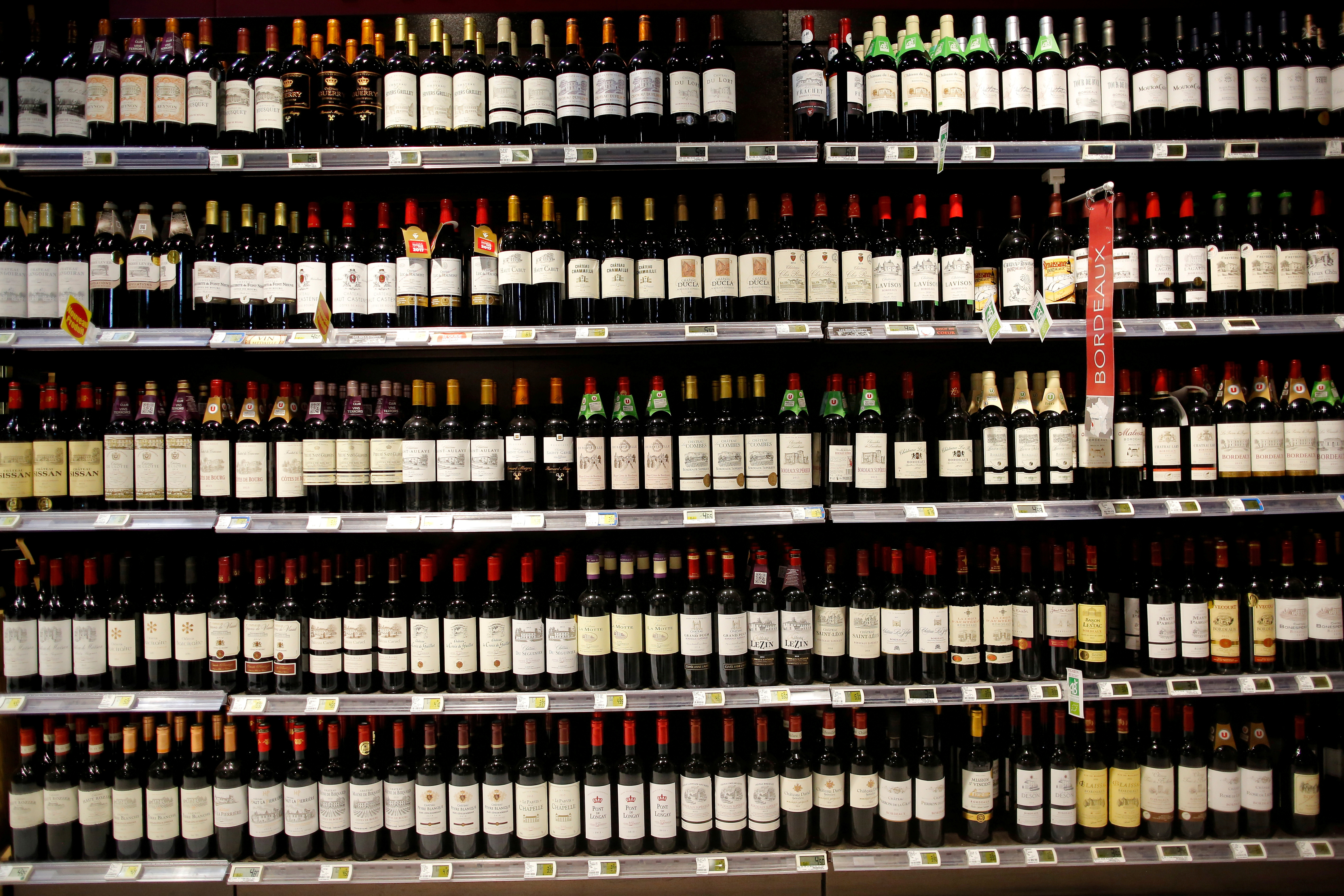Bottles of French wine are displayed for sale in a supermarket in Vertou, near Nantes, France, June 20, 2017.   REUTERS/Stephane Mahe