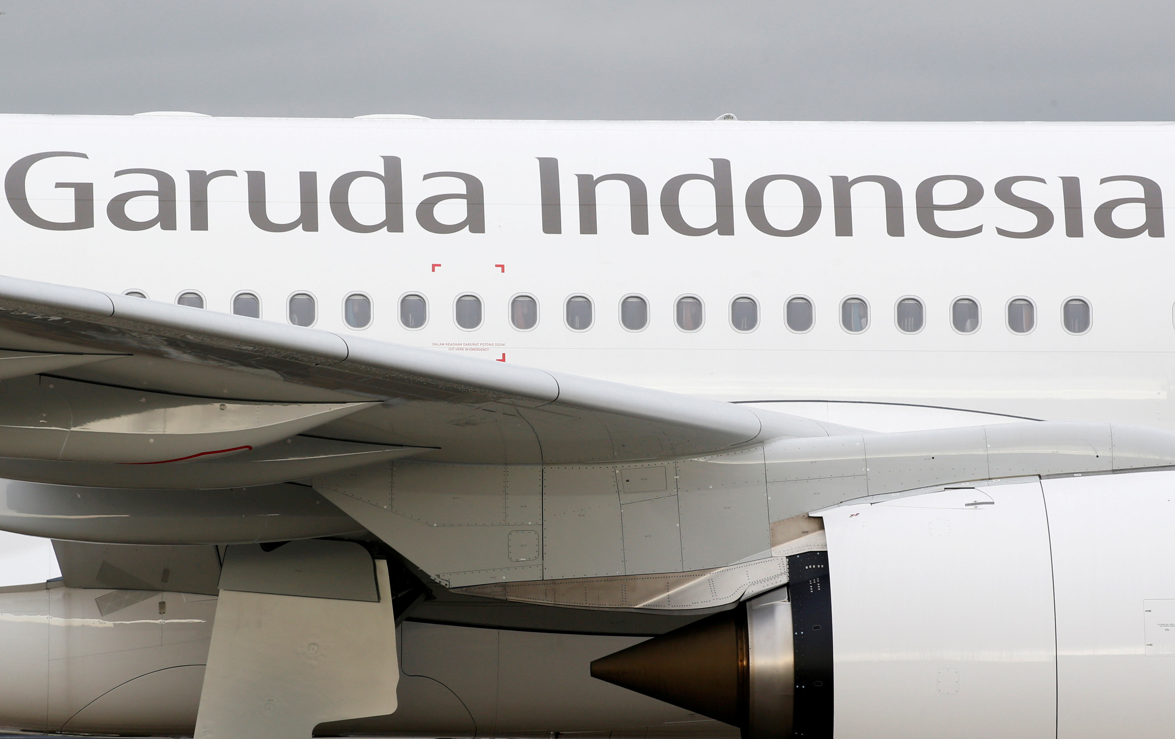 The logo of Garuda Indonesia is pictured on an Airbus A330 aircraft parked at the aircraft builder's headquarters of Airbus in Colomiers near Toulouse, France, November 15, 2019. REUTERS/Regis Duvignau/File Photo