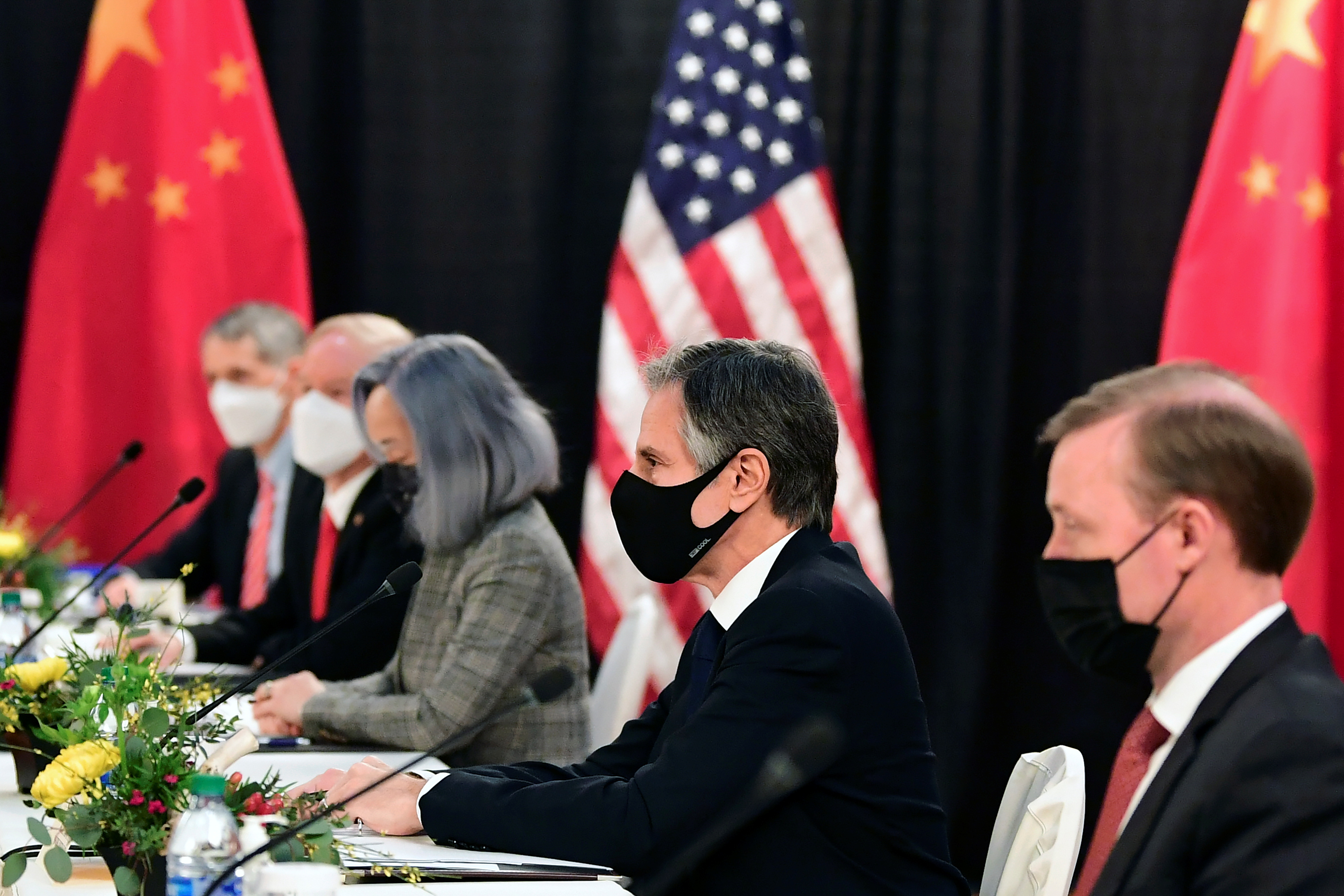 The U.S. delegation led by Secretary of State Antony Blinken (C) and flanked by National Security Advisor Jake Sullivan (R), face their Chinese counterparts at the opening session of U.S.-China talks at the Captain Cook Hotel in Anchorage, Alaska on March 18, 2021.  Frederic J. Brown/Pool via REUTERS