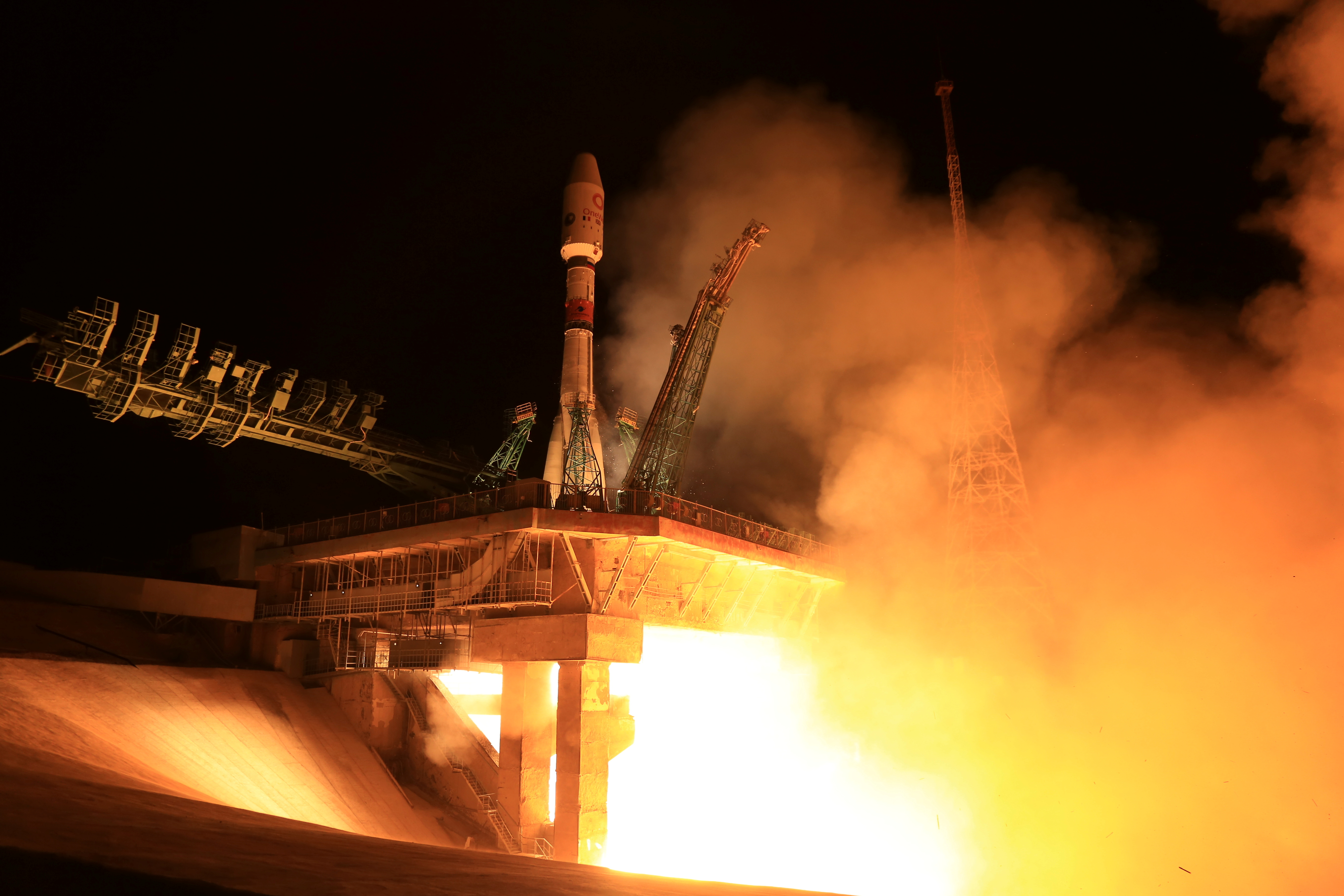 A Soyuz-2.1b rocket booster with a Fregat upper stage and satellites of British firm OneWeb blasts off from a launchpad at the Baikonur Cosmodrome, Kazakhstan September 14, 2021. Roscosmos/Handout via REUTERS
