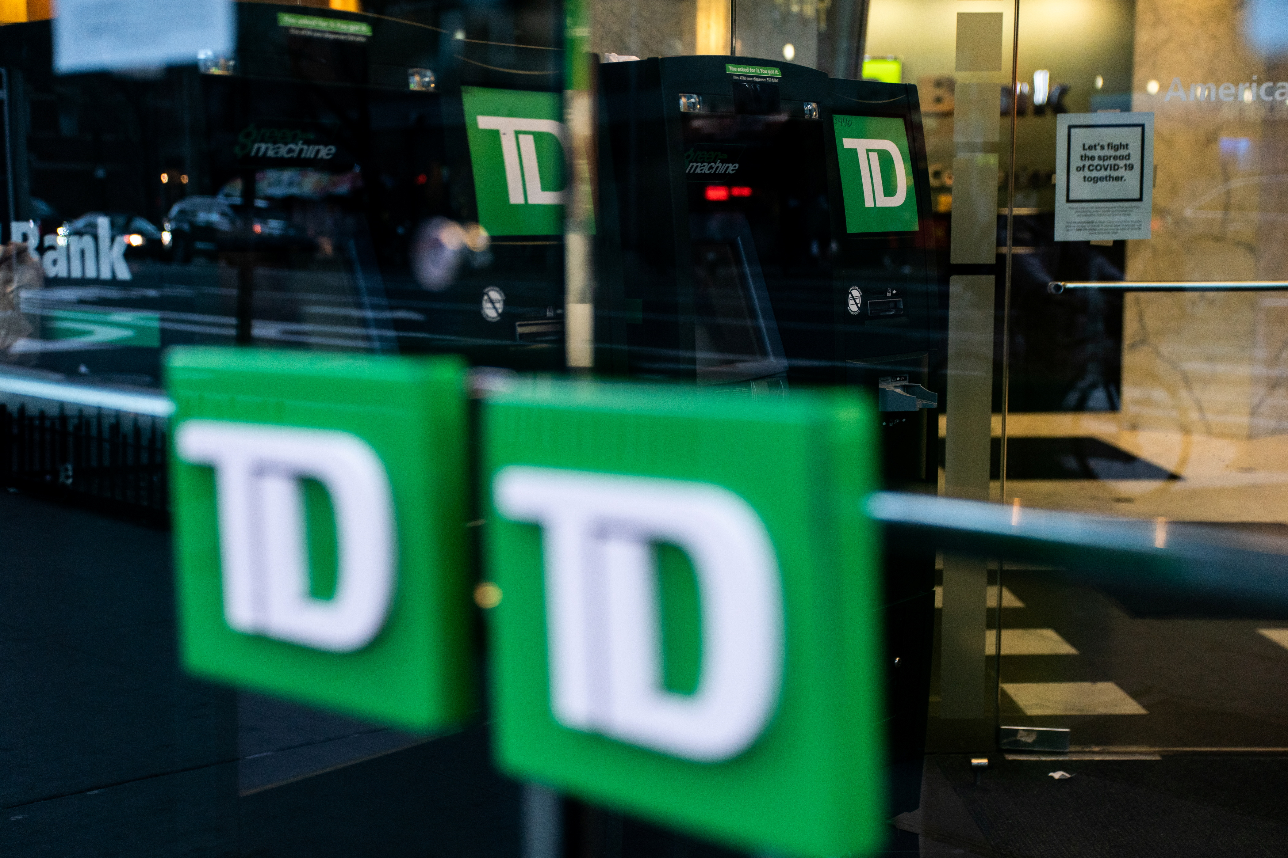 TD bank ATM machines are seen in New York City, U.S., March 17, 2020. REUTERS/Jeenah Moon/File Photo