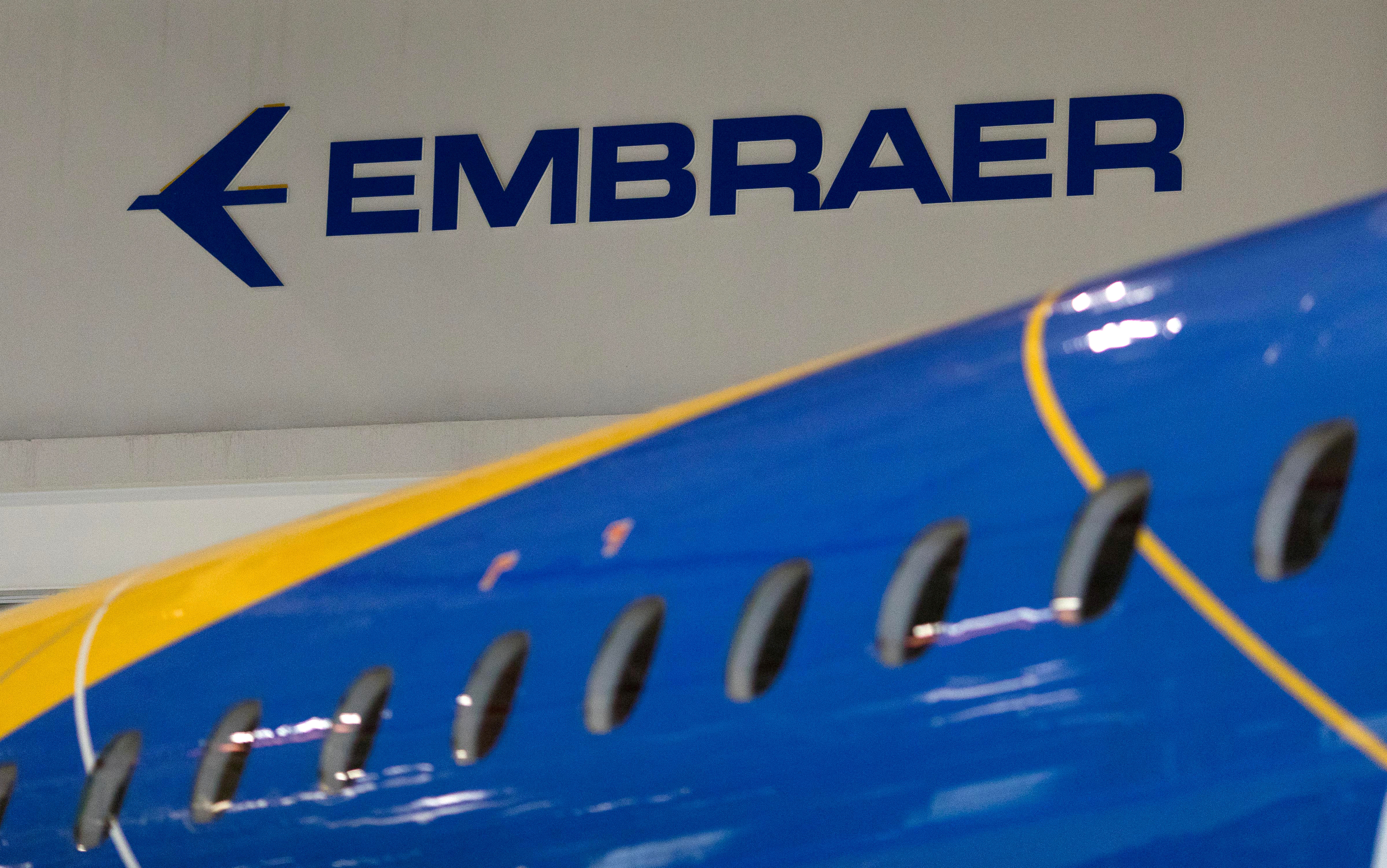 The logo of Brazilian planemaker Embraer SA is seen at the company's headquarters in Sao Jose dos Campos, Brazil February 28, 2018. REUTERS/Roosevelt Cassio/File Photo