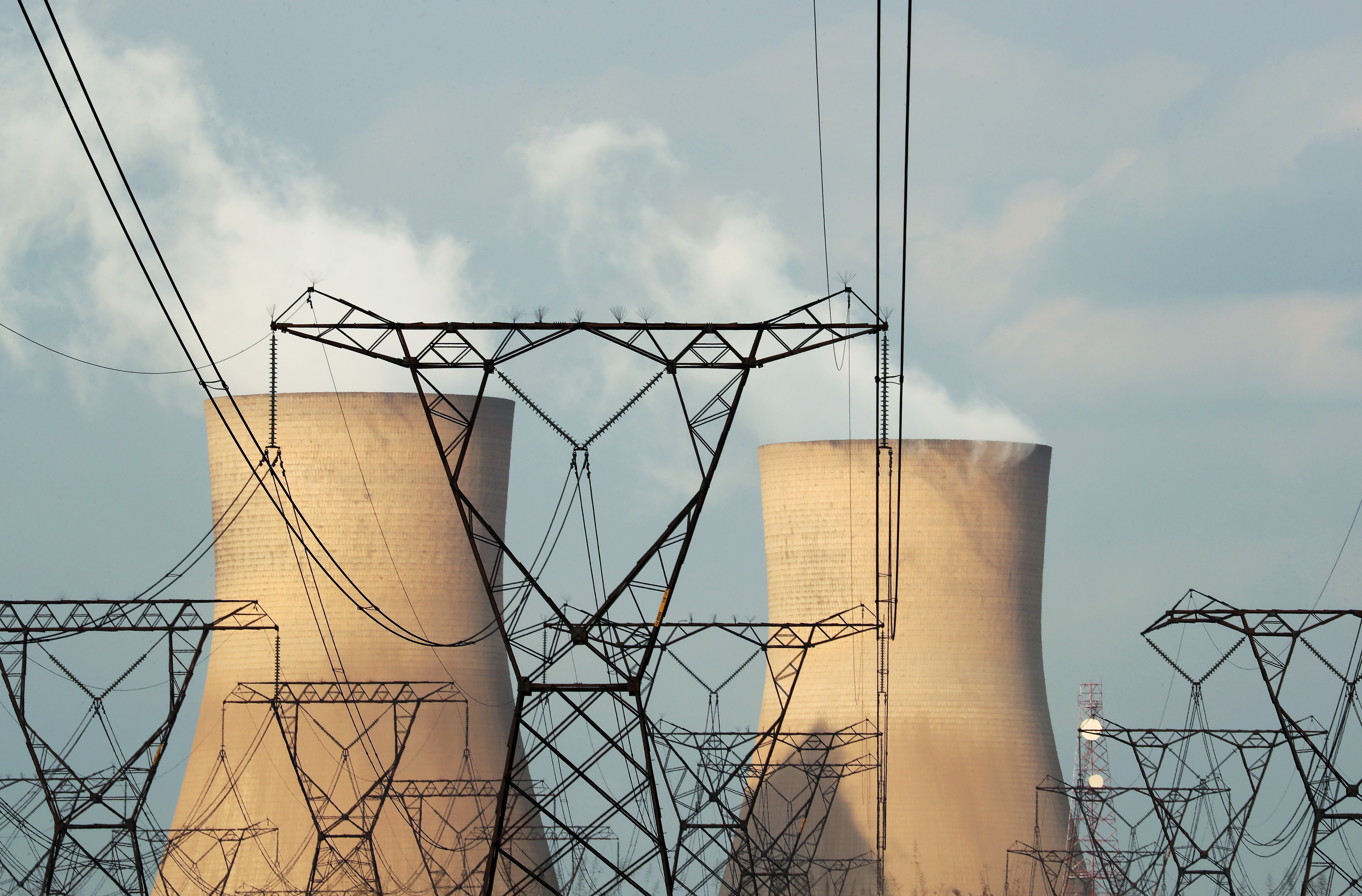 Cooling towers are pictured at a coal-based power station owned by state power utility Eskom in Duhva, South Africa, February 18, 2020. REUTERS/Mike Hutchings/File Photo