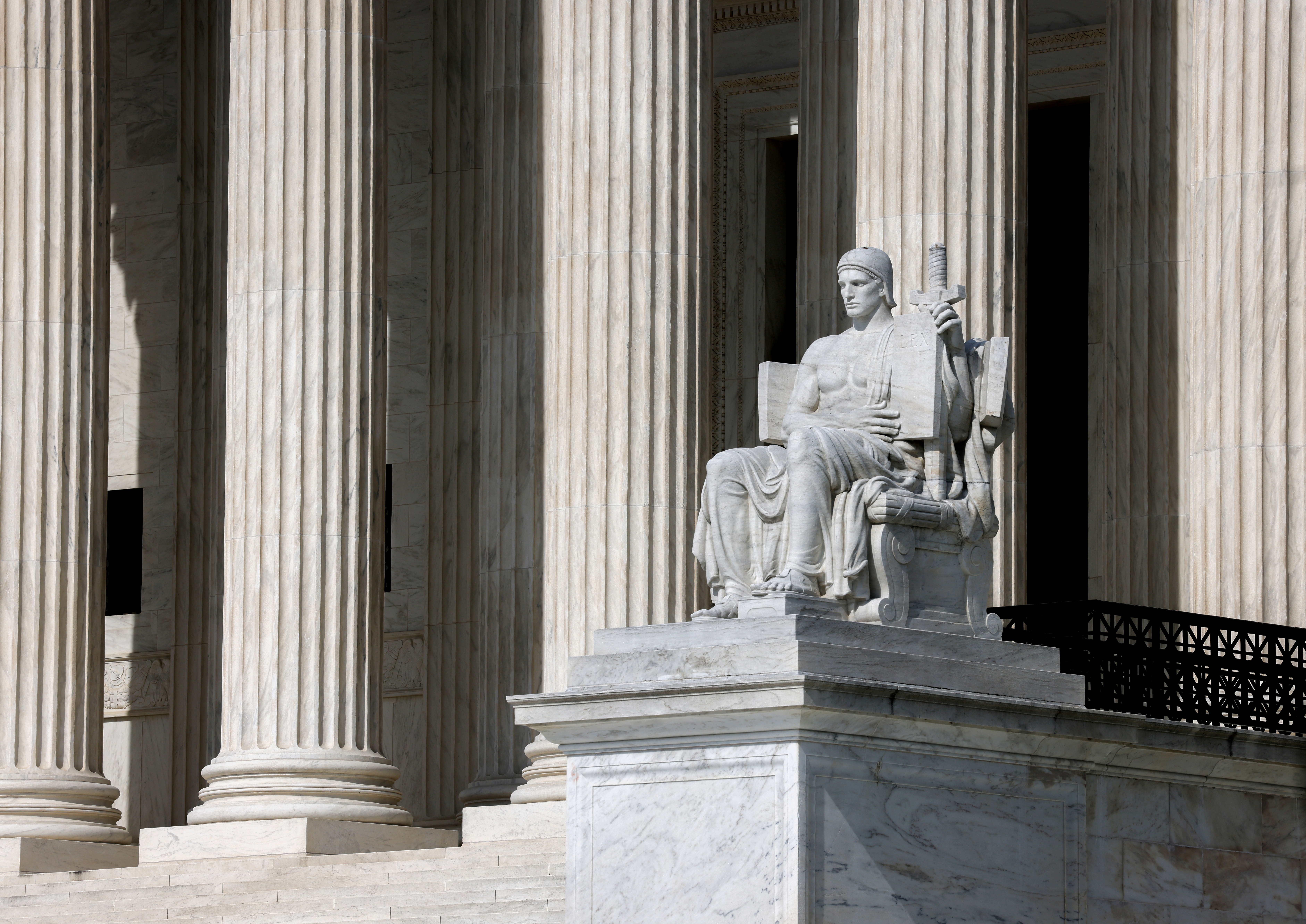 The Authority of Law statue outside the United States Supreme Court in Washington, U.S., May 17, 2021. REUTERS/Evelyn Hockstein/File Photo