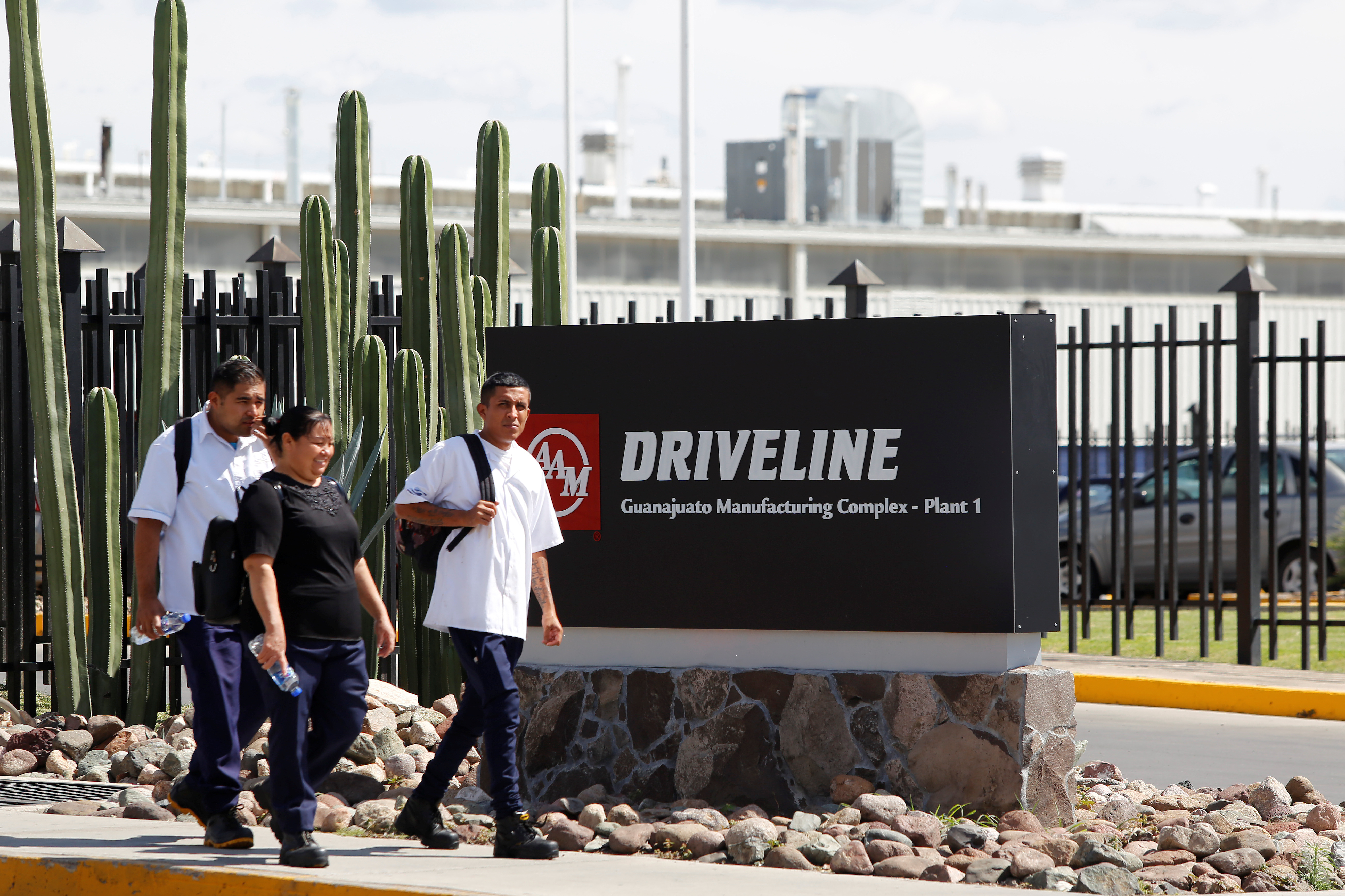 Employees leave American Axle & Manufacturing (AAM) plant, an automotive supplier to GM, in Silao, Mexico October 9, 2019. REUTERS/Sergio Maldonado