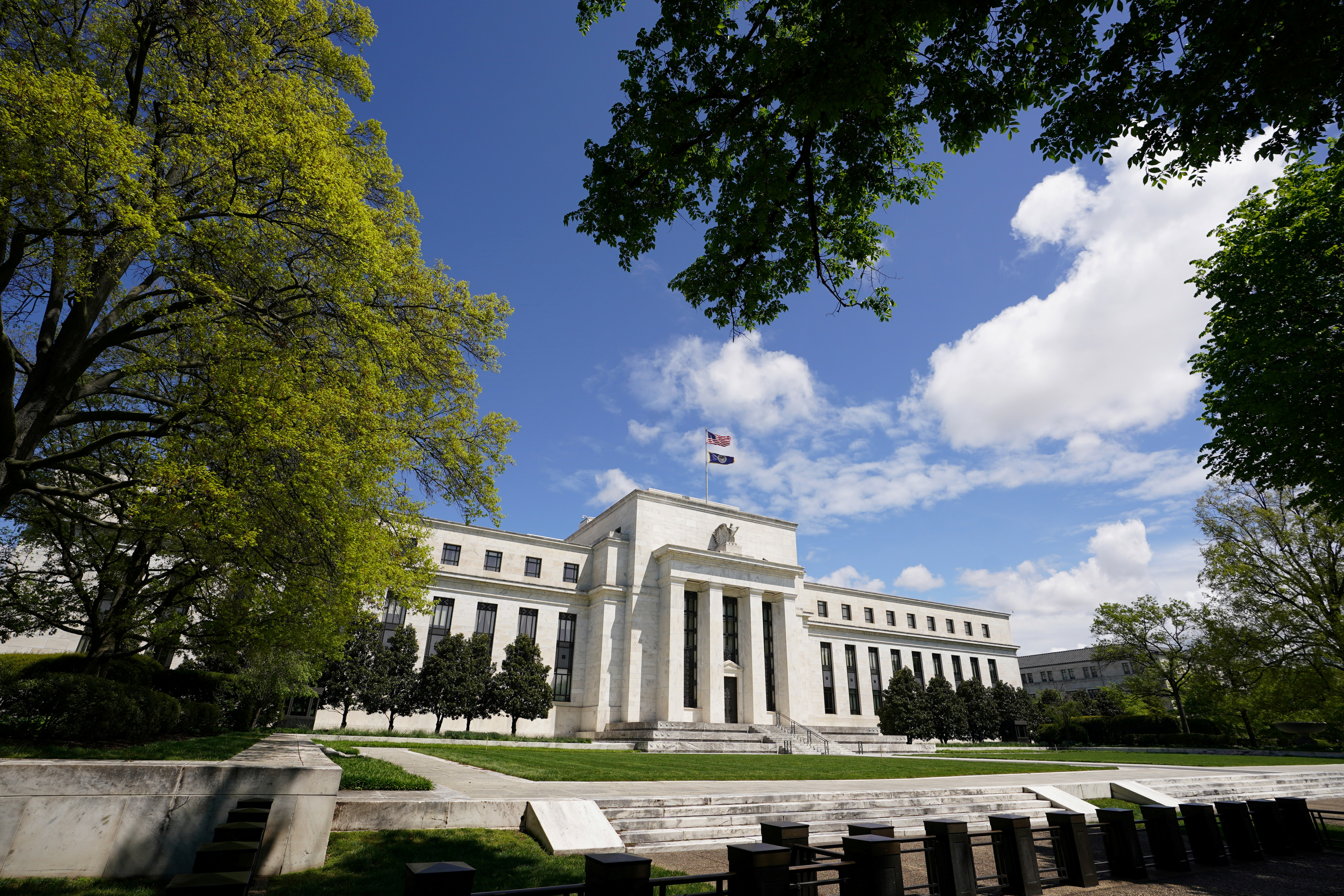 The Federal Reserve building is set against a blue sky in Washington, U.S., May 1, 2020. REUTERS/Kevin Lamarque/File Photo