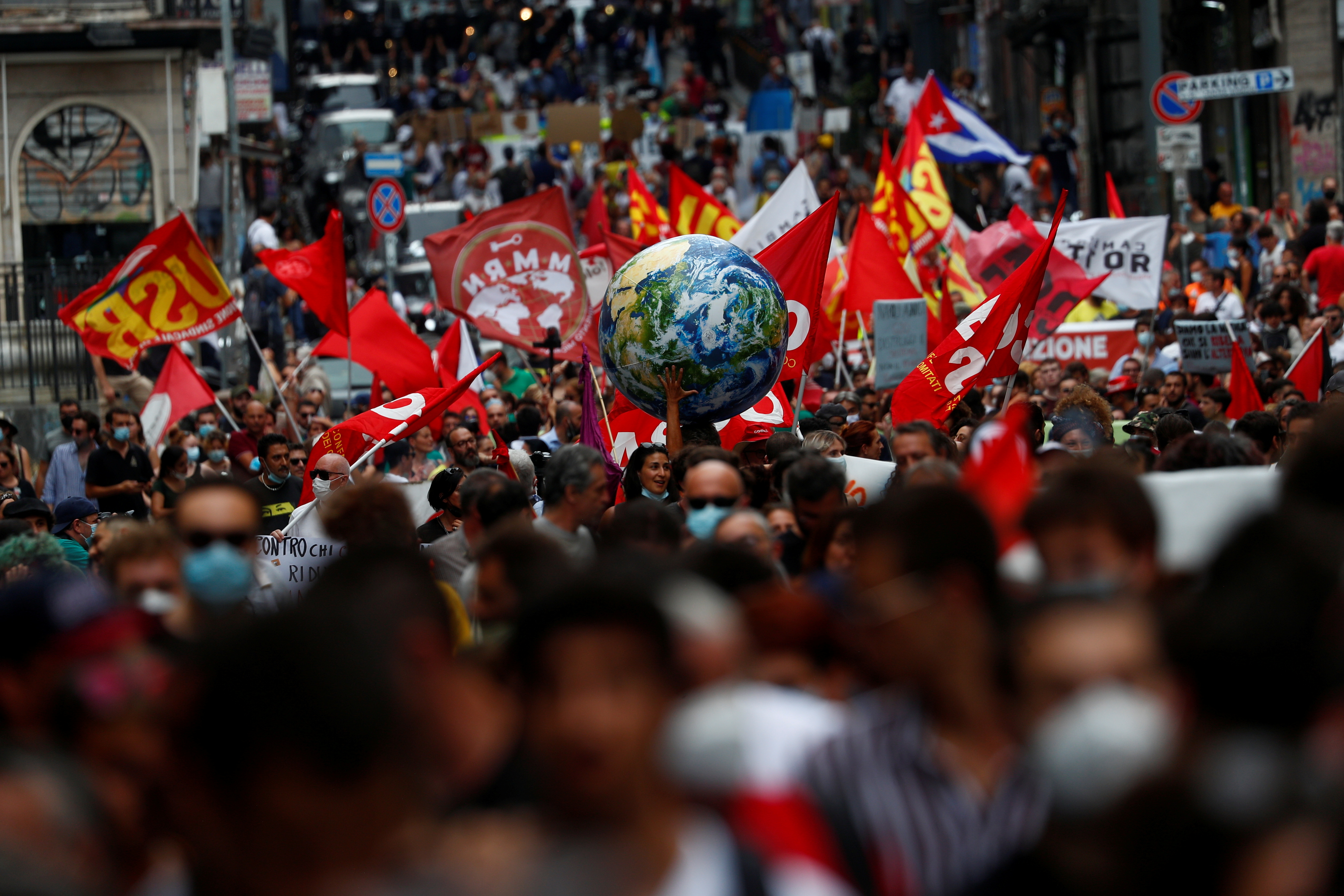 A person holds inflatable Earth as climate activists including Extinction Rebellion and Fridays for Future stage a protest demanding more action whilst G20 climate and environment ministers hold a meeting in Naples, Italy, July 22, 2021. REUTERS/Guglielmo Mangiapane/File Photo