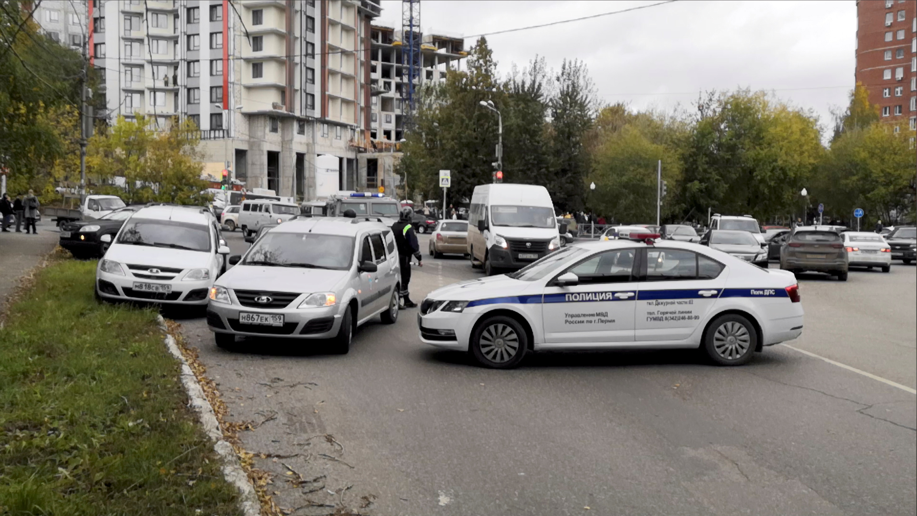 Police block the road near the scene after a gunman opened fire at the Perm State University in Perm, Russia September 20, 2021, in this still image taken from video. REUTERS/Anna Vikhareva