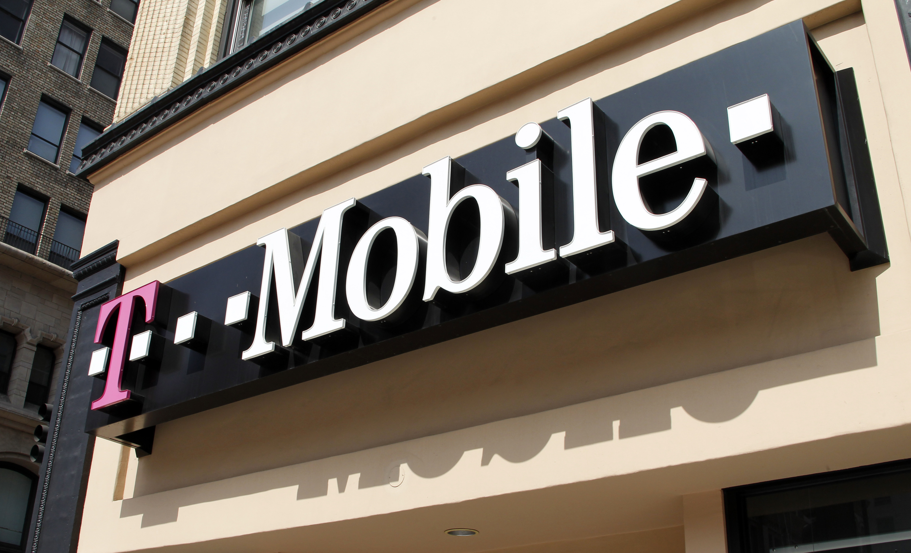 Signage for a T-Mobile store is pictured in downtown Los Angeles, California.     REUTERS/Fred Prouser