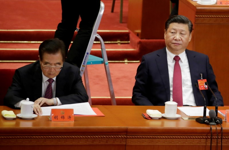 Chinese President Xi Jinping  (R) and former President Hu Jintao attend the closing session of the 19th National Congress of the Communist Party of China at the Great Hall of the People, in Beijing, China October 24, 2017. REUTERS/Jason Lee/File Photo