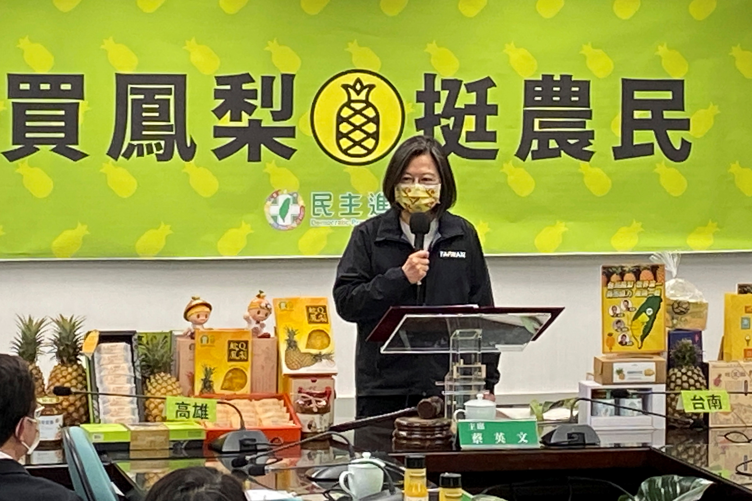 Taiwan President Tsai Ing-wen attends an event promoting Taiwanese pineapples after China announced a ban on imports of the fruit from Taiwan, in Taipei, Taiwan March 3, 2021. REUTERS/Ben Blanchard