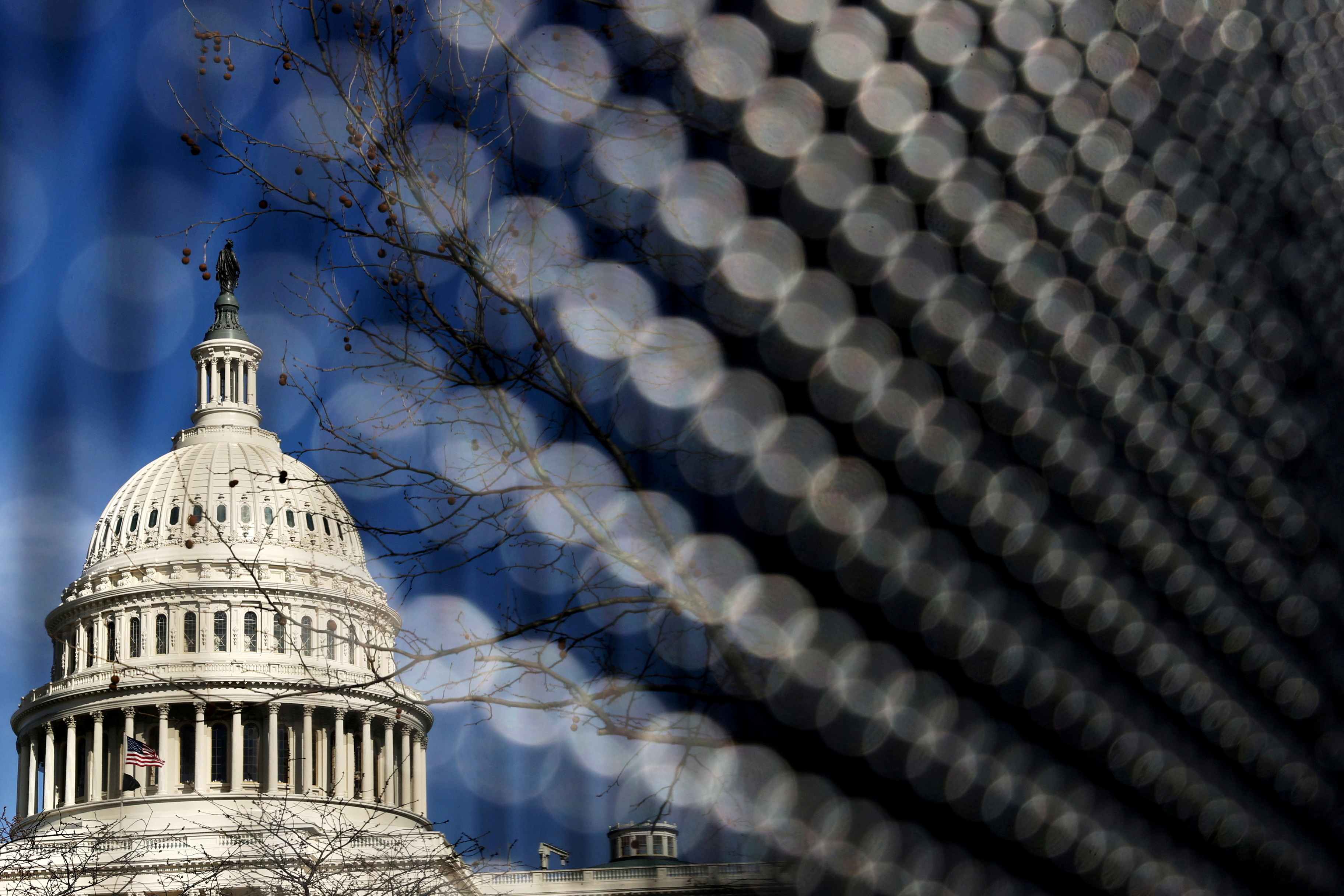 Light catches a security fence around the U.S. Capitol, in Washington, March 15, 2021. REUTERS/Jonathan Ernst/File Photo