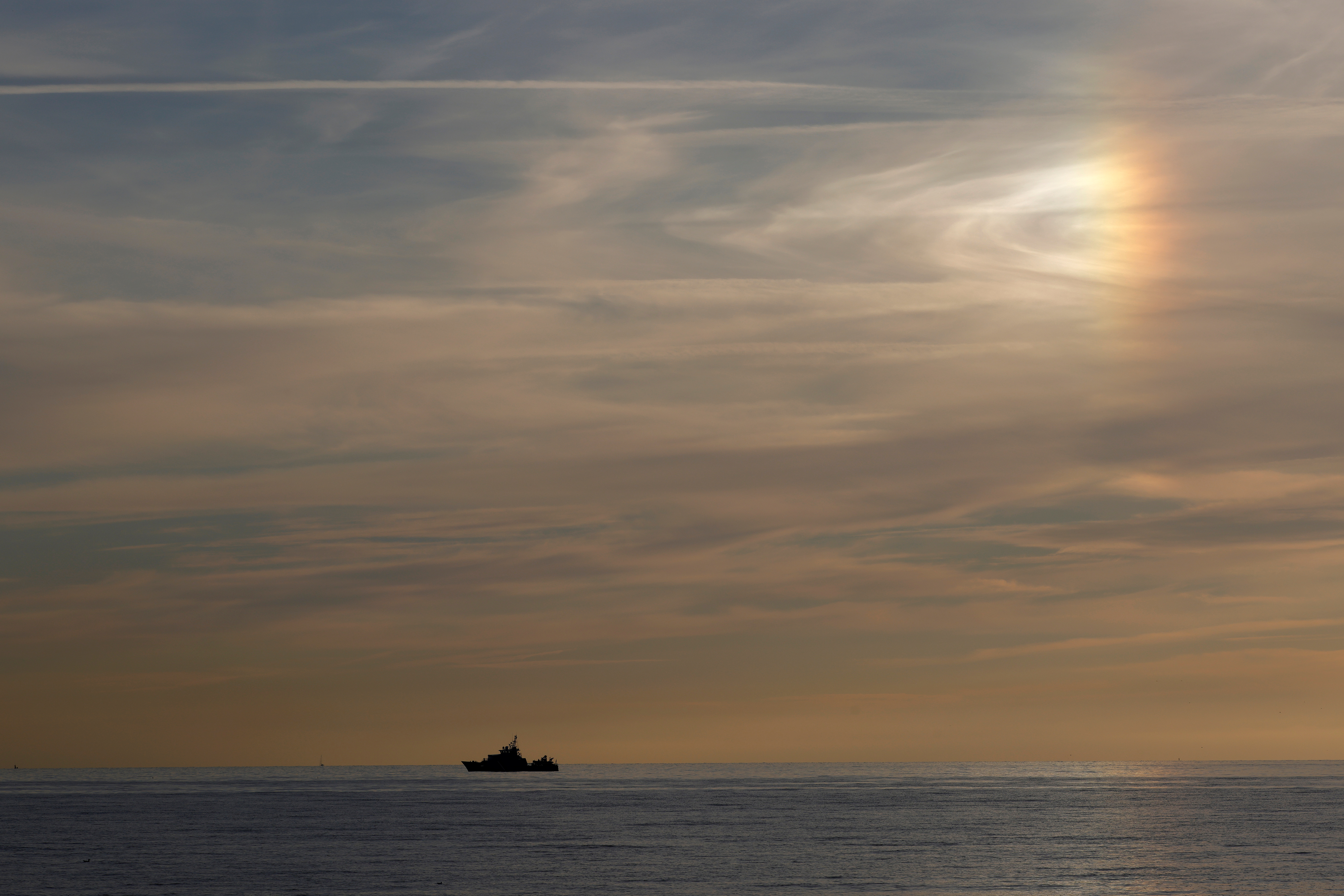 A coast guard boat patrols along the French coast in Wimereux, France, September 12, 2021. REUTERS/Pascal Rossignol
