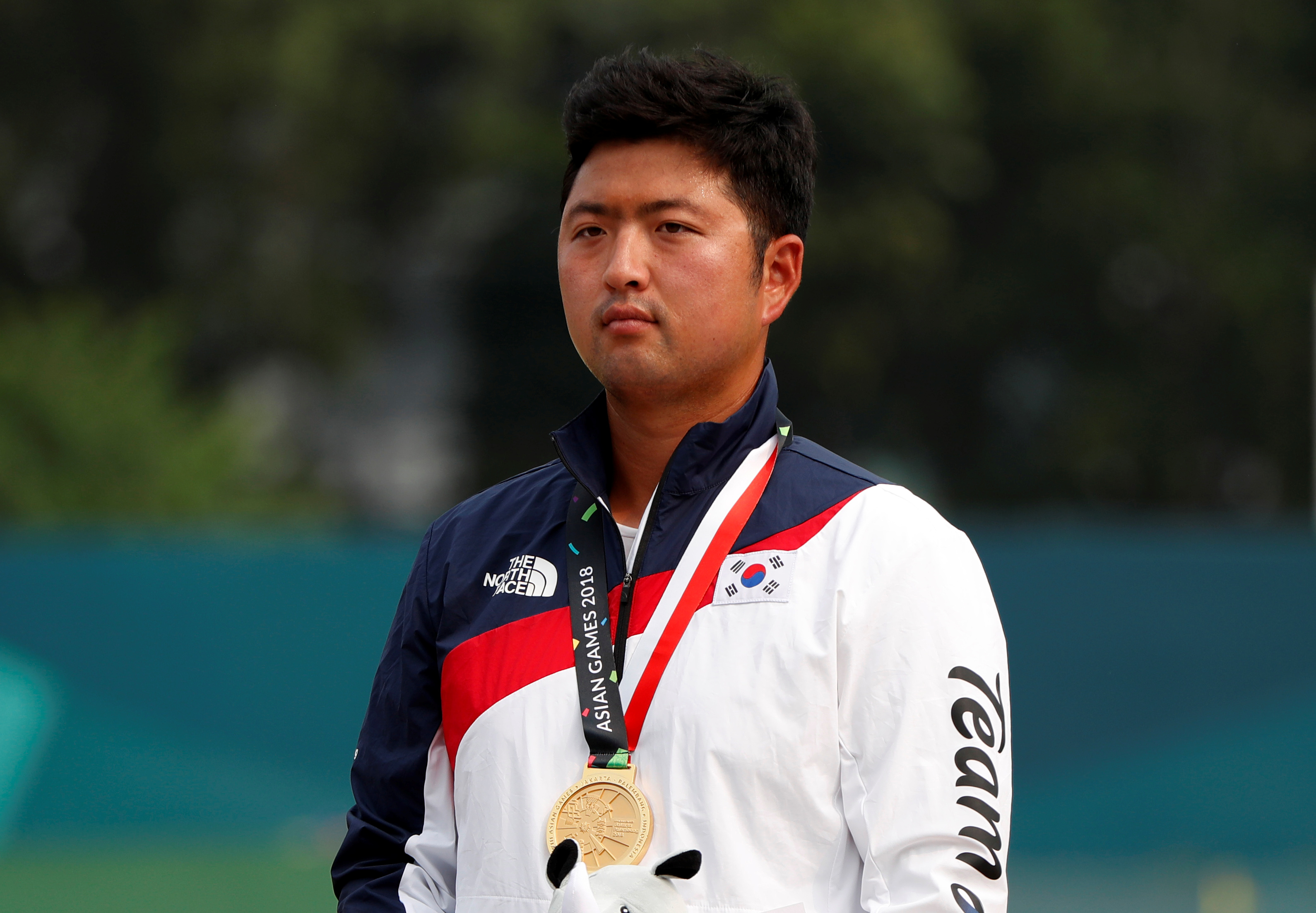 Archery - 2018 Asian Games - Recurve Men's Individual Finals - GBK Archery Field - Jakarta, Indonesia - August 28, 2018 - Gold Medallist Kim Woojin of South Korea poses with his medal. REUTERS/Issei Kato