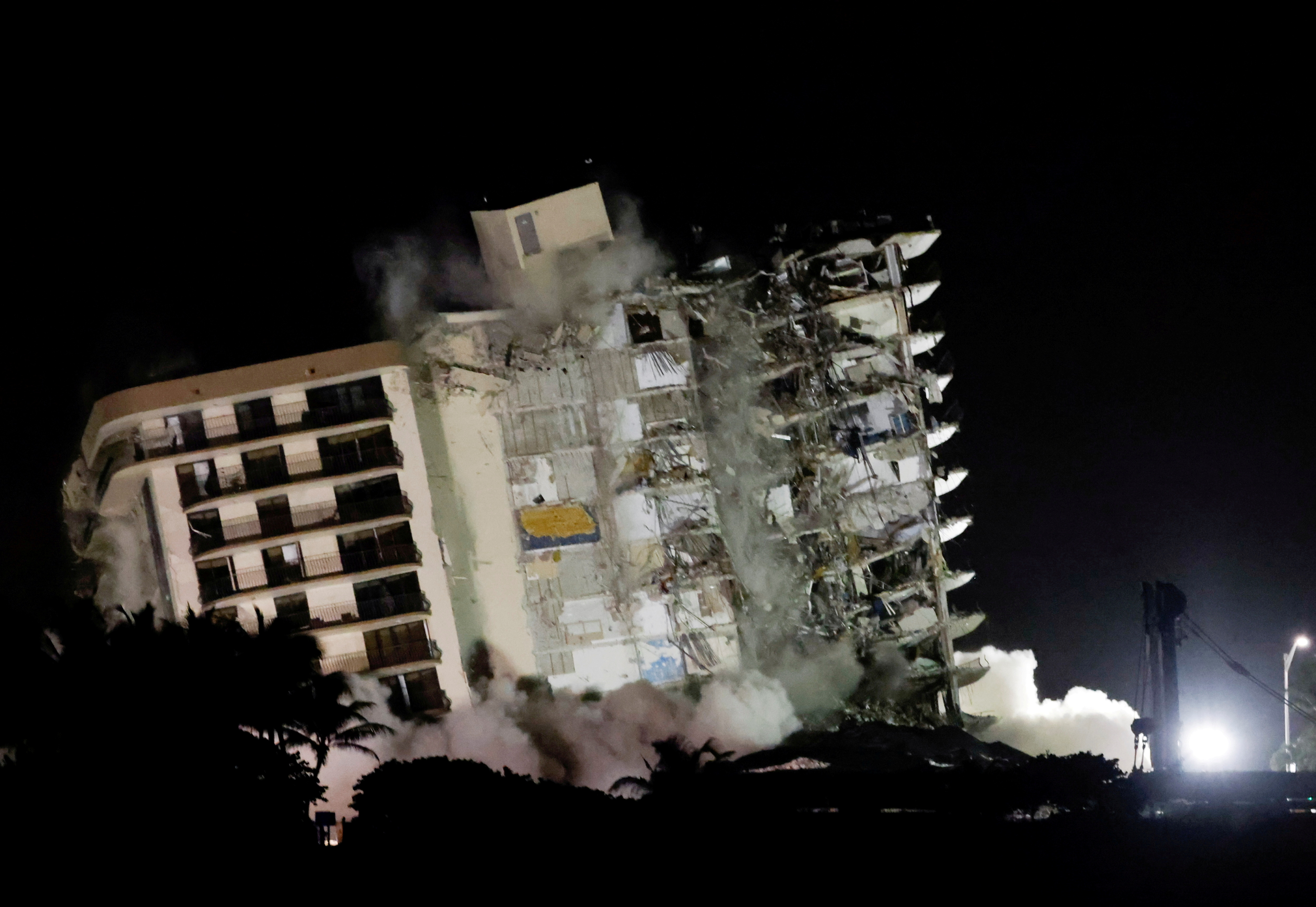 The partially collapsed Champlain Towers South residential building is demolished, in Surfside, Florida, July 4, 2021. REUTERS/Marco Bello/File Photo