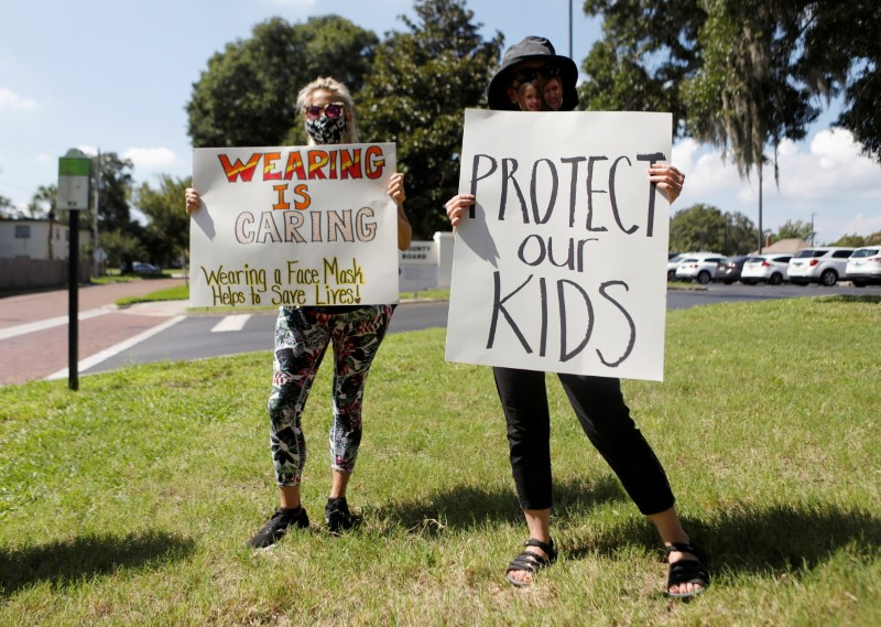 Supporters of wearing masks in schools protest before the special called school board workshop at the Pinellas County Schools Administration Building in Largo, Florida, U.S., August 9, 2021. REUTERS/Octavio Jones