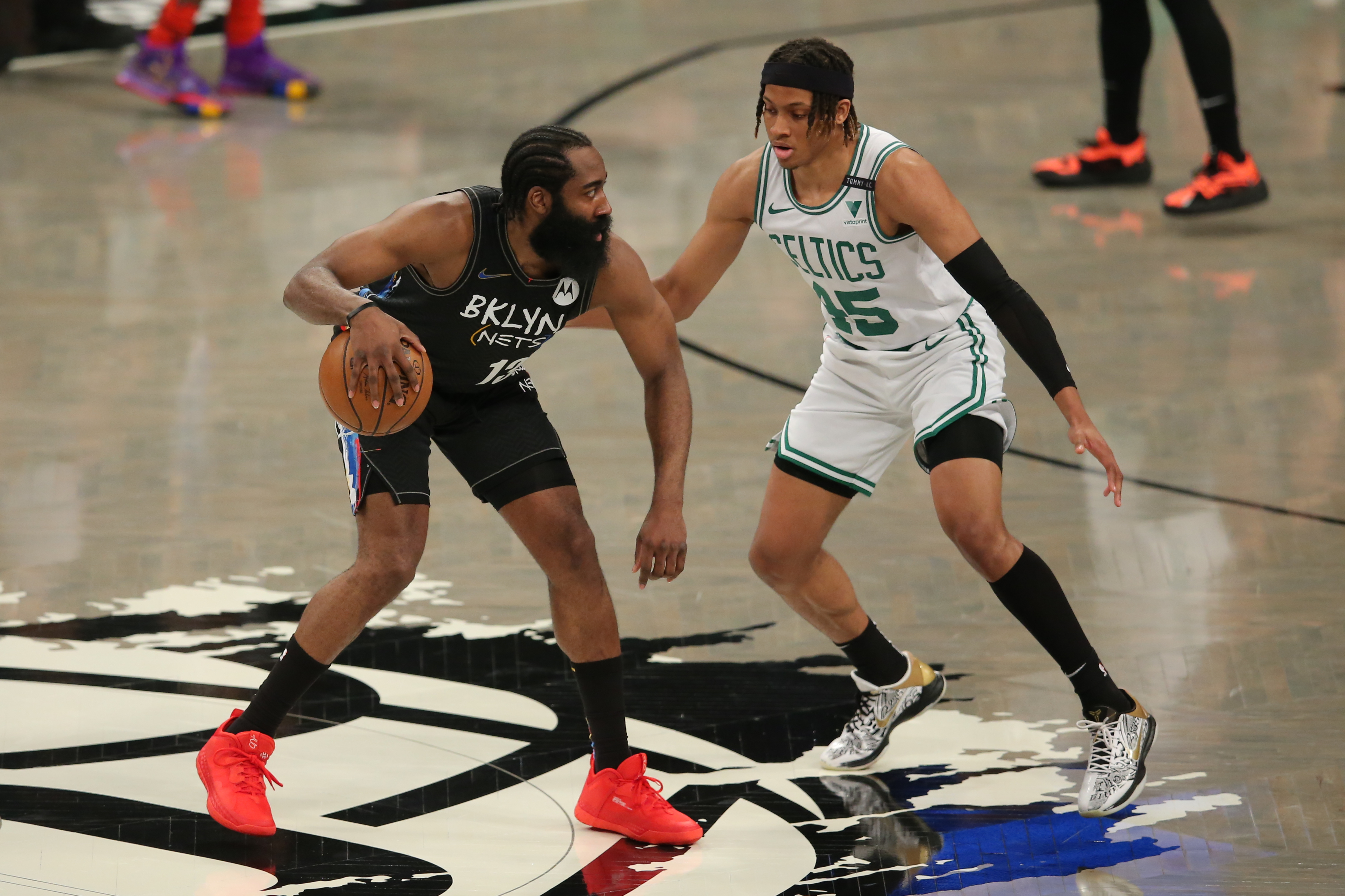 Jun 1, 2021; Brooklyn, New York, USA; Brooklyn Nets shooting guard James Harden (13) controls the ball against Boston Celtics shooting guard Romeo Langford (45) during the first quarter of game five of the first round of the 2021 NBA Playoffs at Barclays Center. Mandatory Credit: Brad Penner-USA TODAY Sports