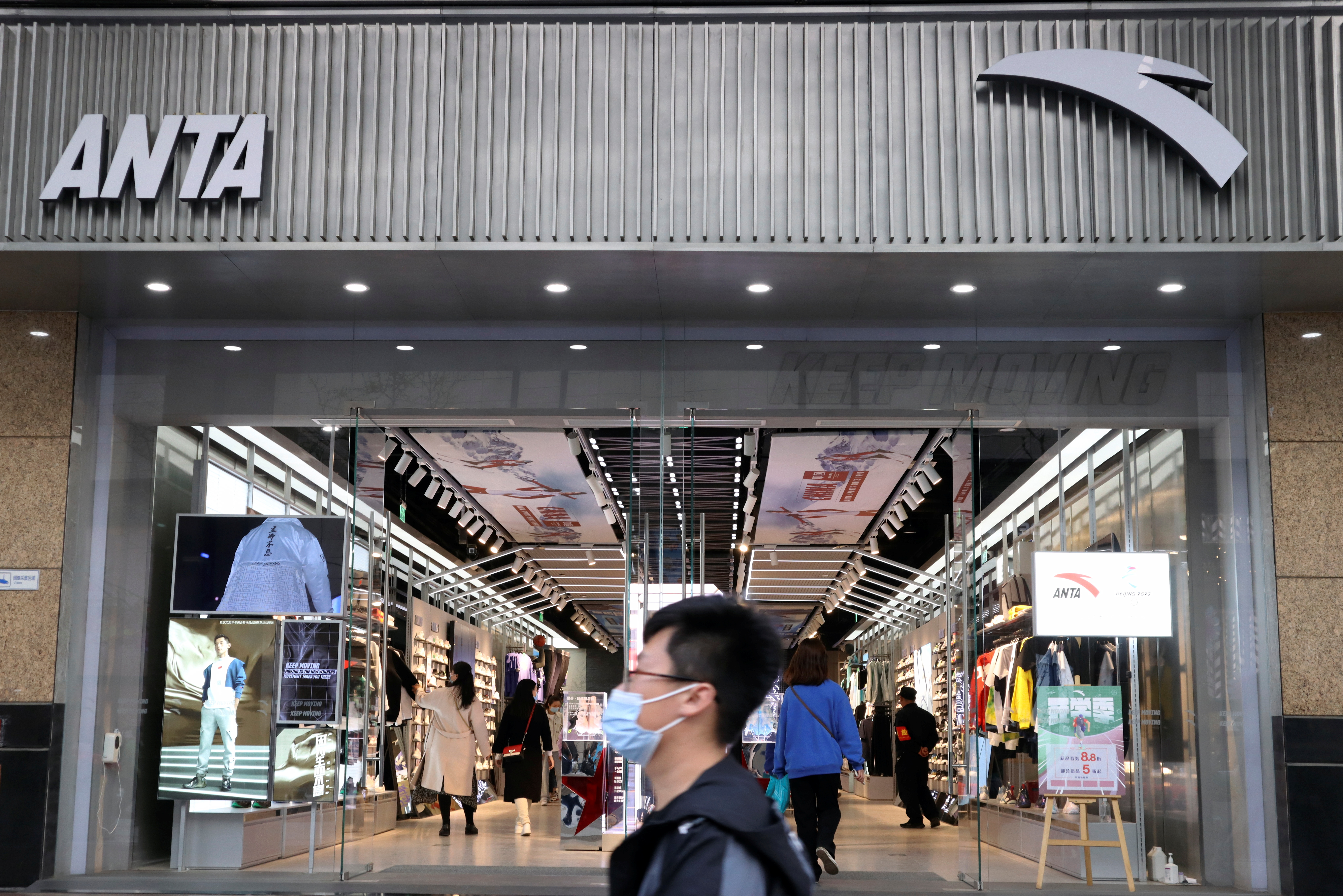 A man walks past a store of Chinese sportswear firm Anta Sports at a shopping mall in Beijing, China March 25, 2021. REUTERS/Florence Lo