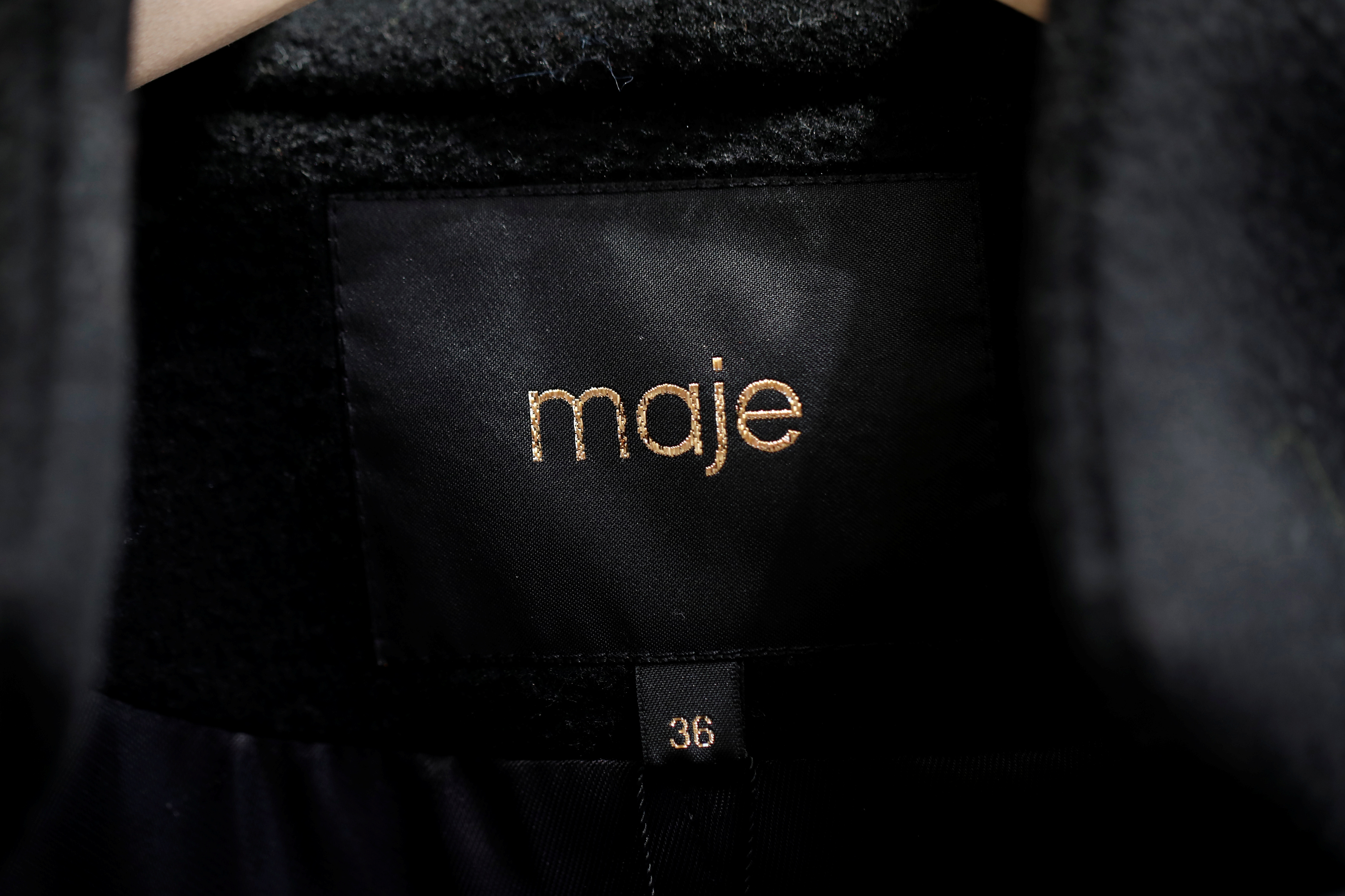 A Maje label is pictured on clothes inside a Maje luxury clothing store, operated by SMCP Group, in Paris, France, December 21, 2017. REUTERS/Benoit Tessier