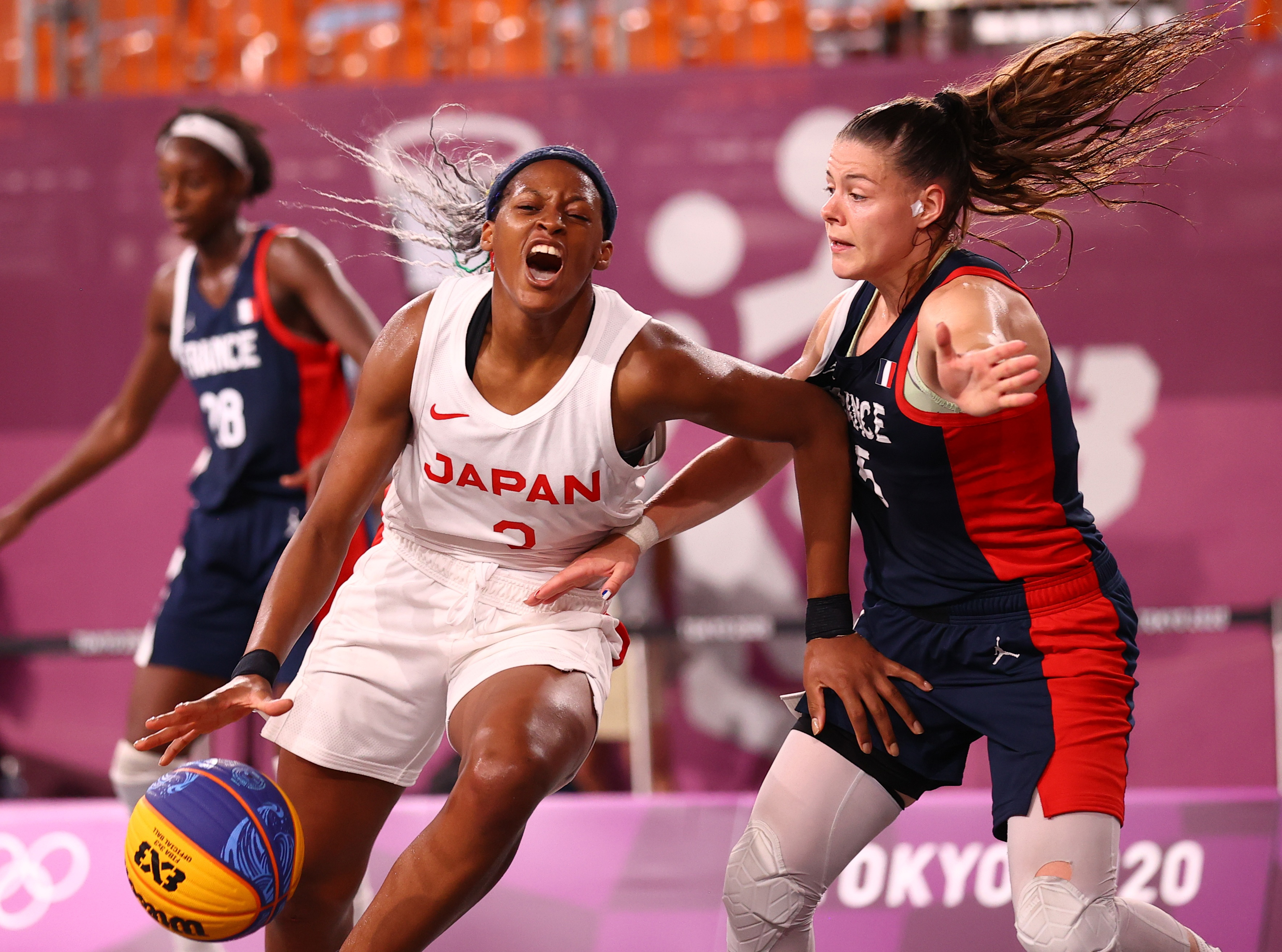 Tokyo 2020 Olympics - Basketball 3x3 - Women - Quarterfinal - Japan v France - Aomi Urban Sports Park, Tokyo Japan - July 27, 2021. Marie-Eve Paget of France in action with Stephanie Mawuli of Japan during the match. REUTERS/Andrew Boyers