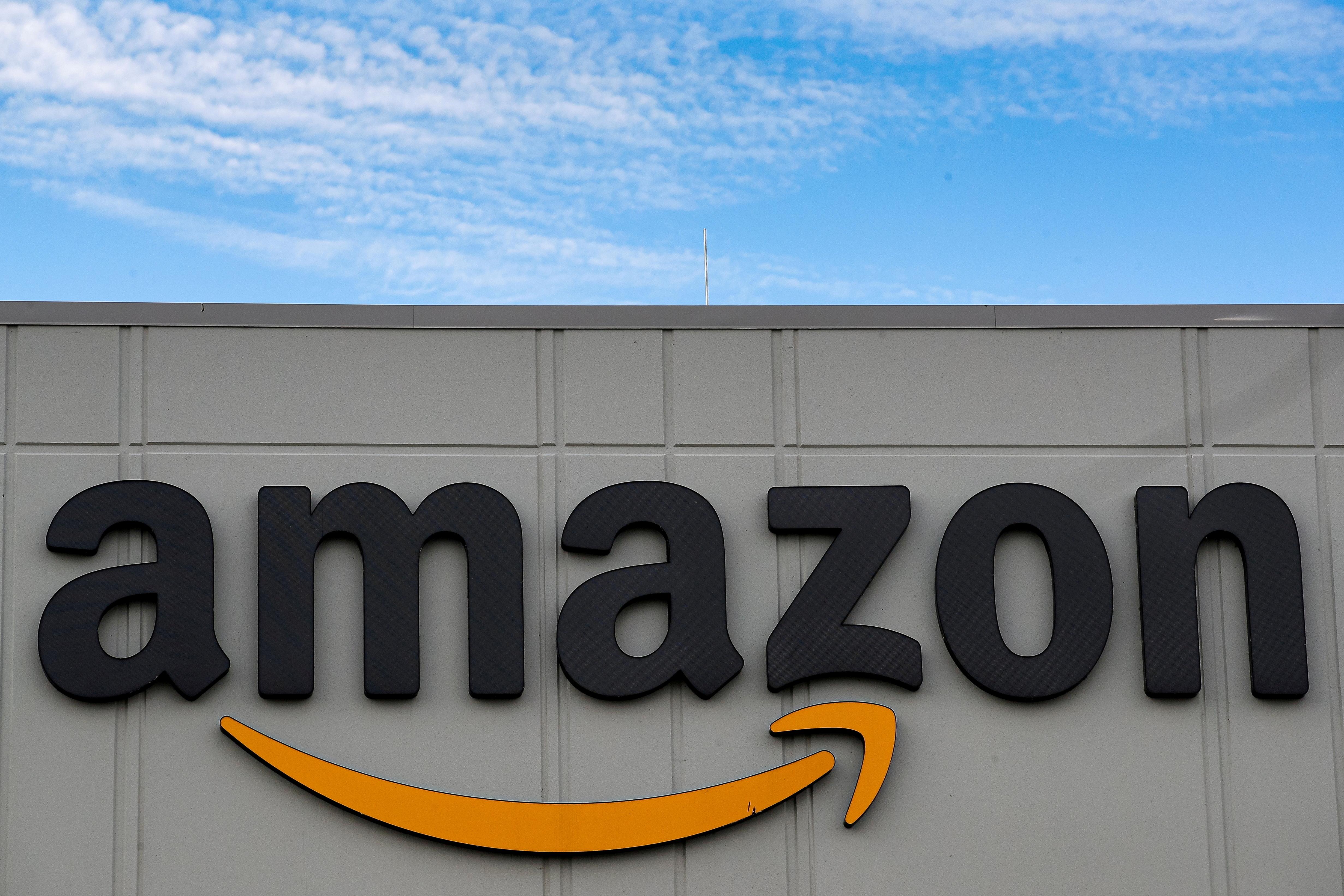 The Amazon logo is seen outside its JFK8 distribution center in Staten Island, New York, U.S. November 25, 2020.  REUTERS/Brendan McDermid/File Photo