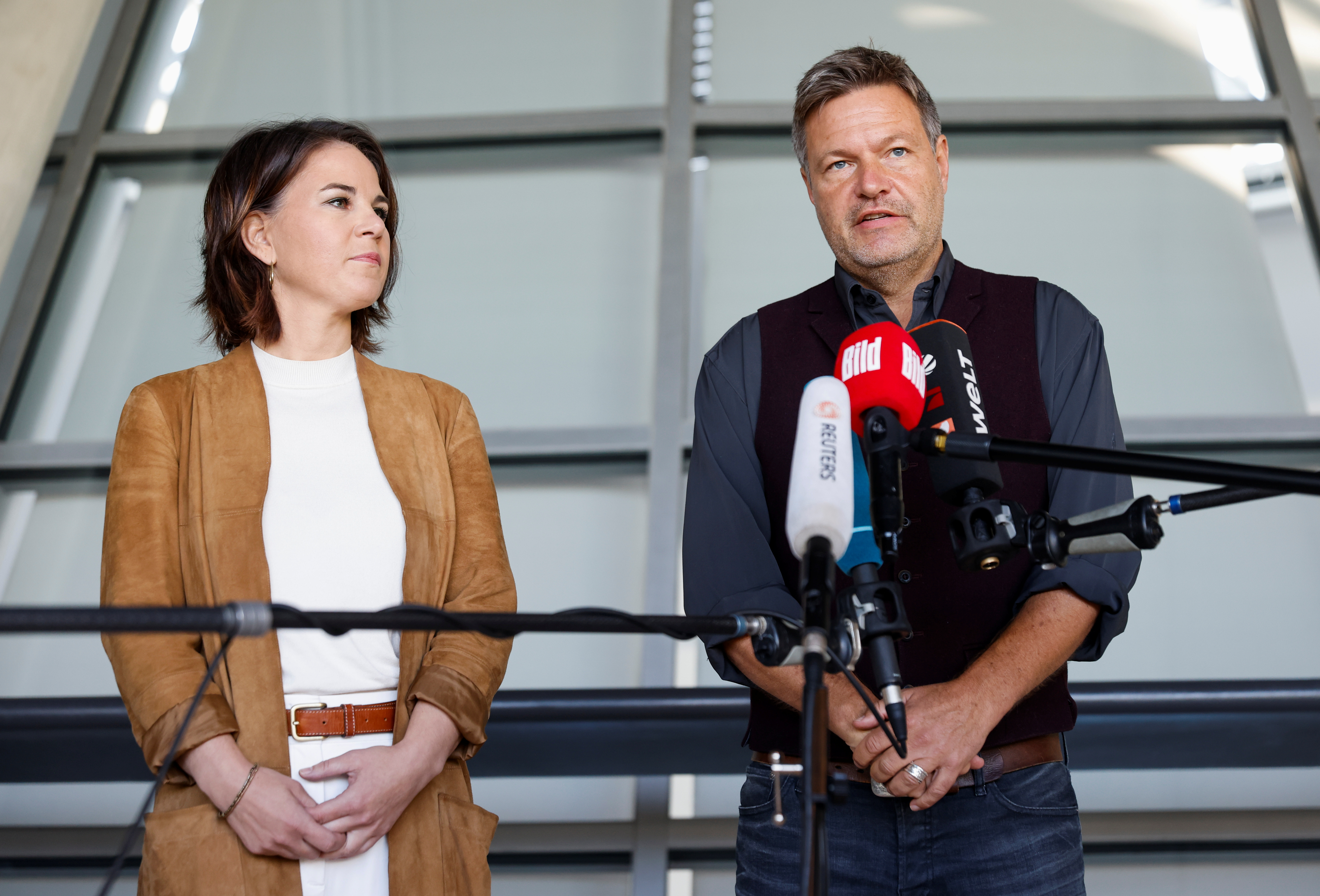 The Greens party co-leaders Annalena Baerbock and Robert Habeck give a statement after a party leadership meeting in Berlin, Germany, October 6, 2021. REUTERS/Michele Tantussi