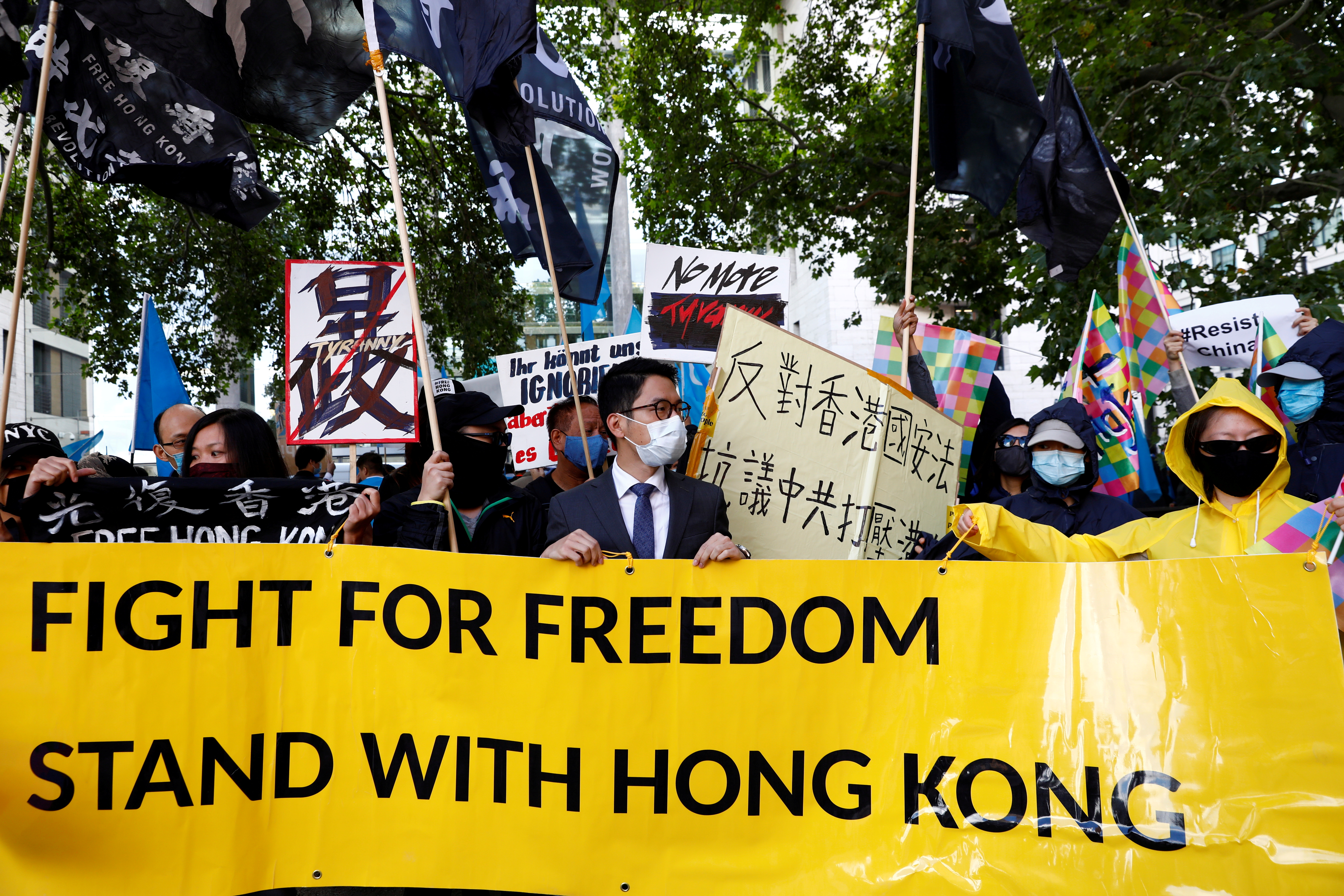 Hong Kong exile pro-democracy activist Nathan Law wearing a face mask holds a rally with other activist groups during China's Foreign Minister Wang Yi's visit in Berlin, Germany September 1, 2020. REUTERS/Michele Tantussi/File Photo