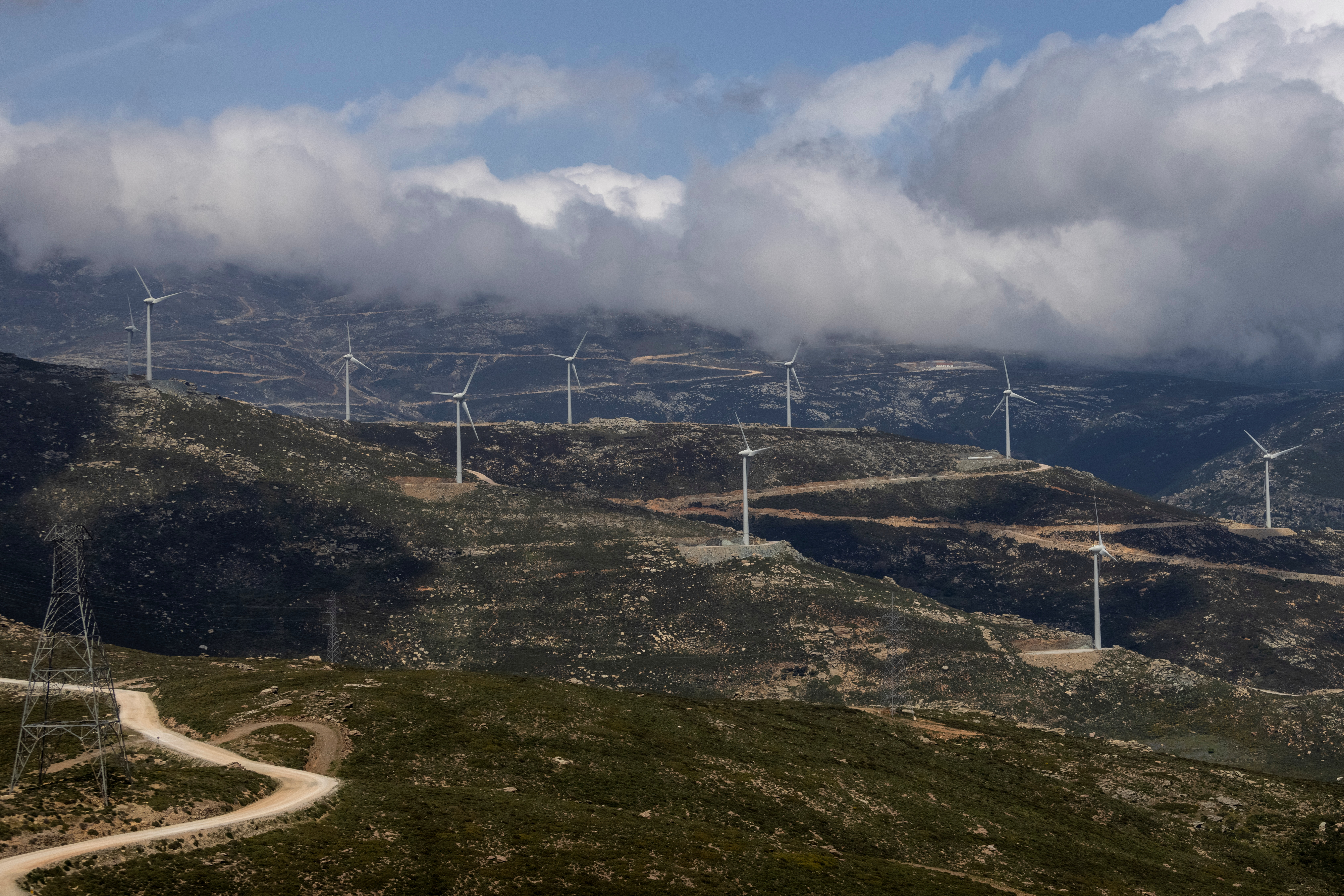 Wind turbines are seen on a mountain on the island of Evia, Greece, April 16, 2021. Picture taken April 16, 2021. REUTERS/Alkis Konstantinidis